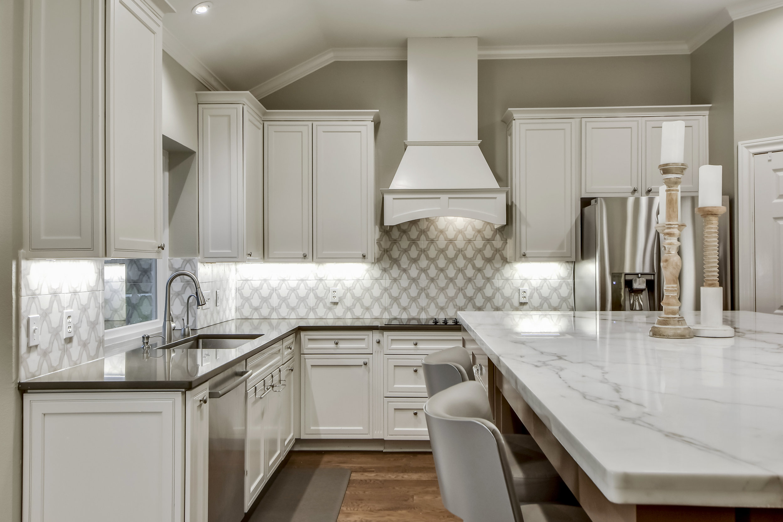 White Kitchen Interior Design with Beautiful Tile Backsplash