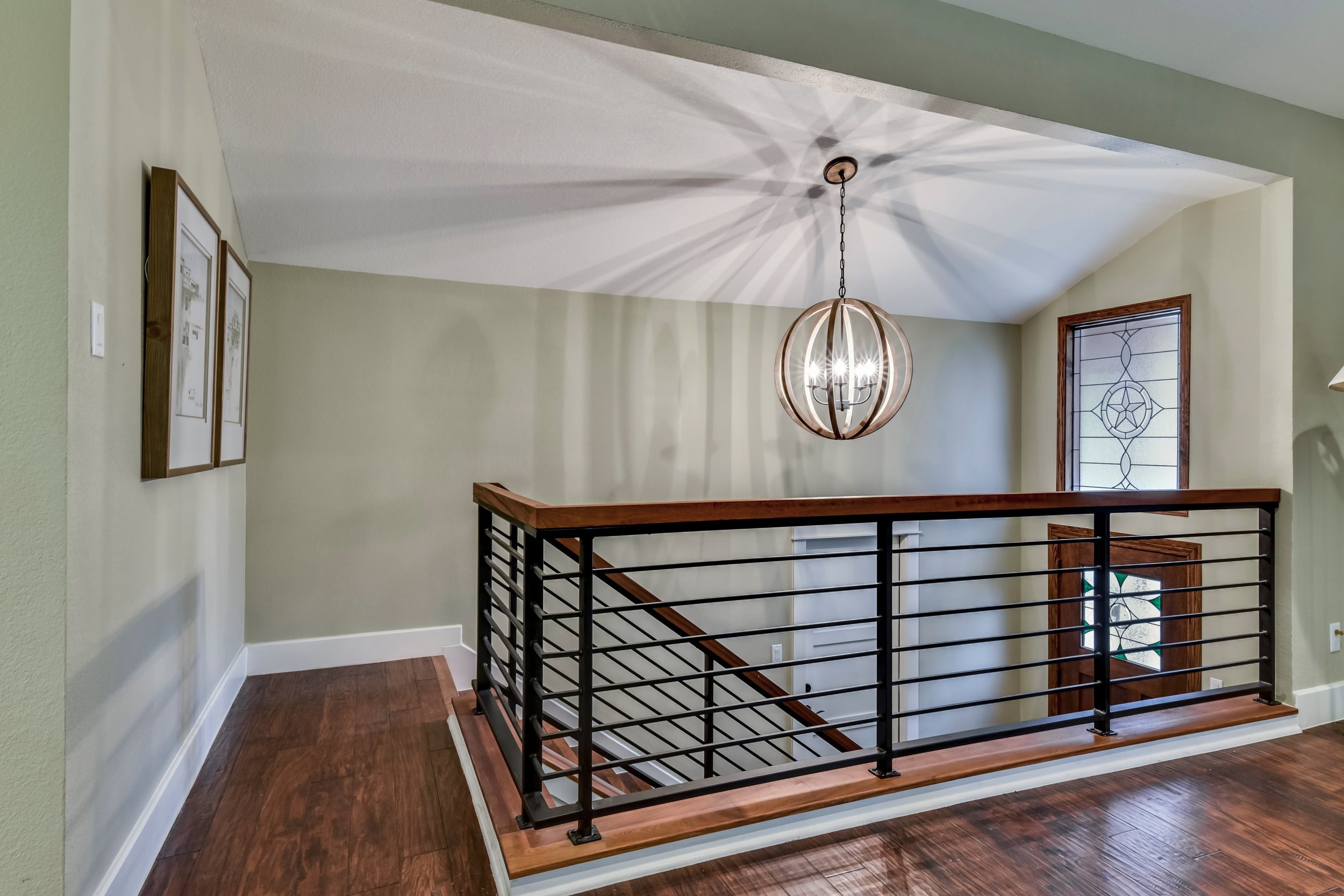 Staircase Chandelier and Stained Glass Window