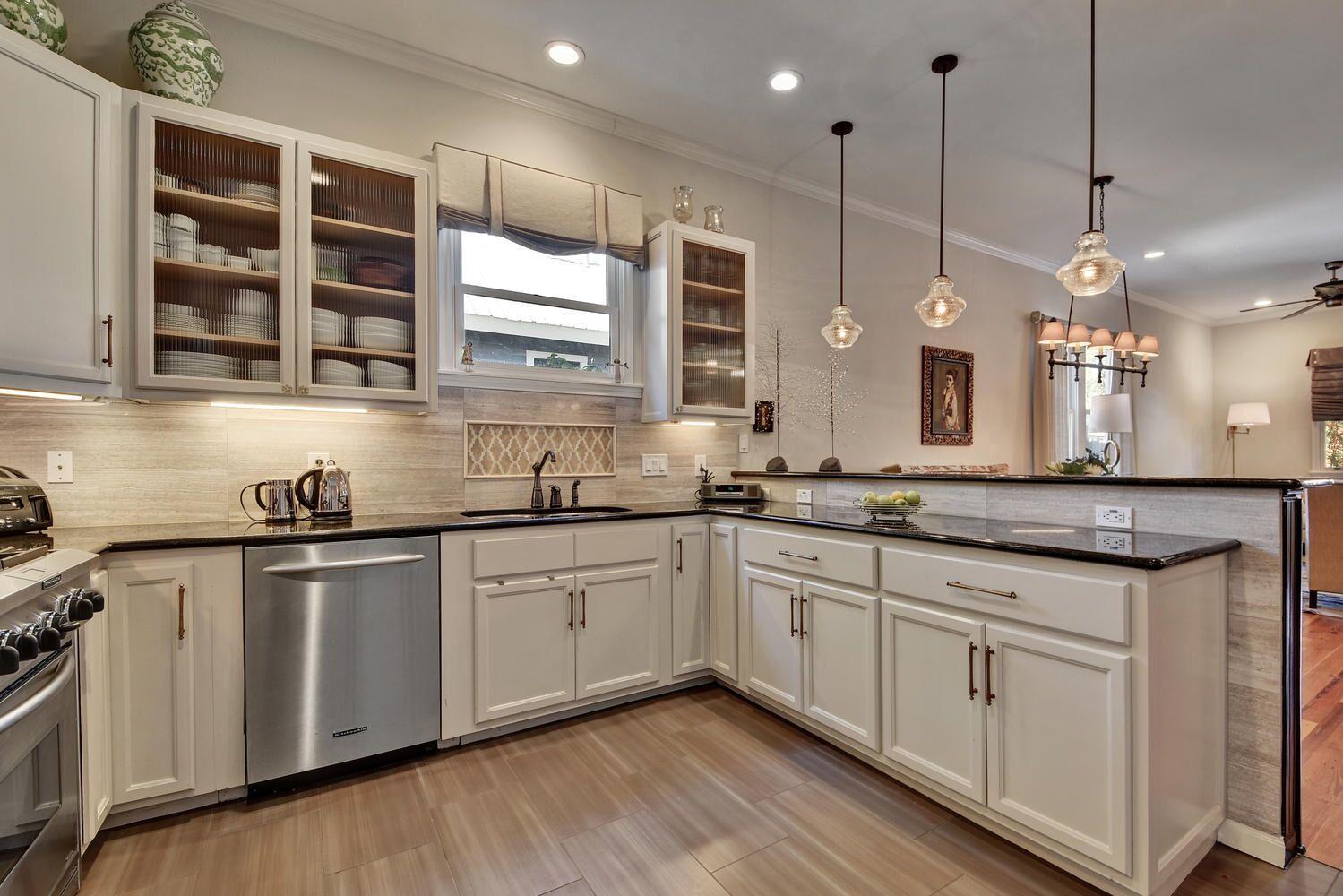 White Kitchen with White Globe Pendant Lights