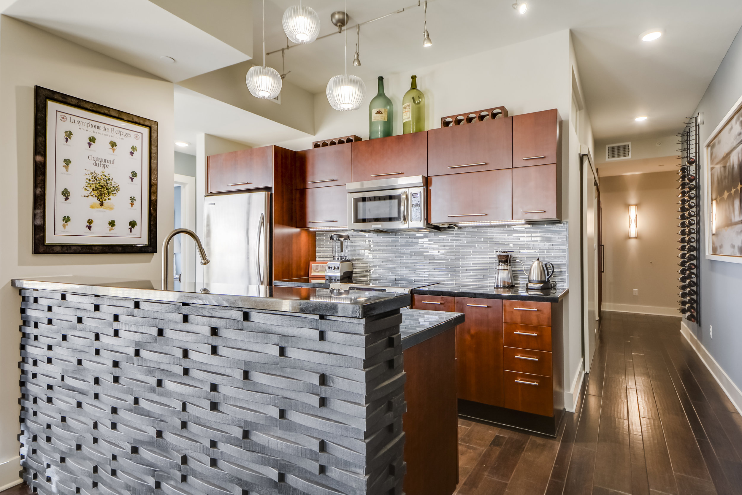 Transitional kitchen design with Glass mosaic backsplash