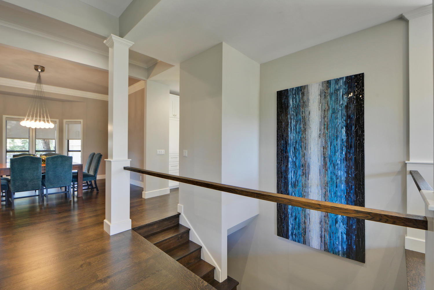 Stairwell art in transitional home