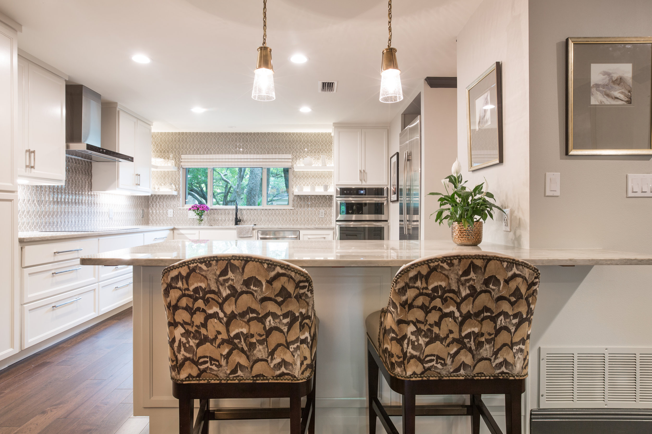 white kitchen remodel with custom barstools in austin texas