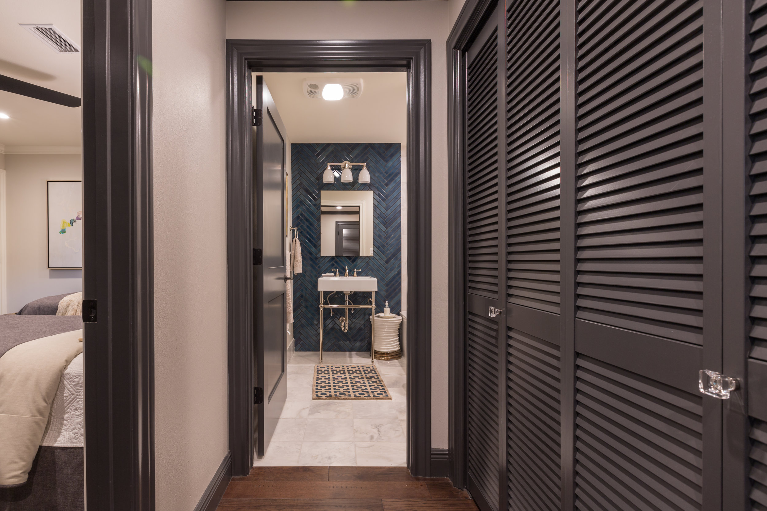 Herringbone guest bathroom tile
