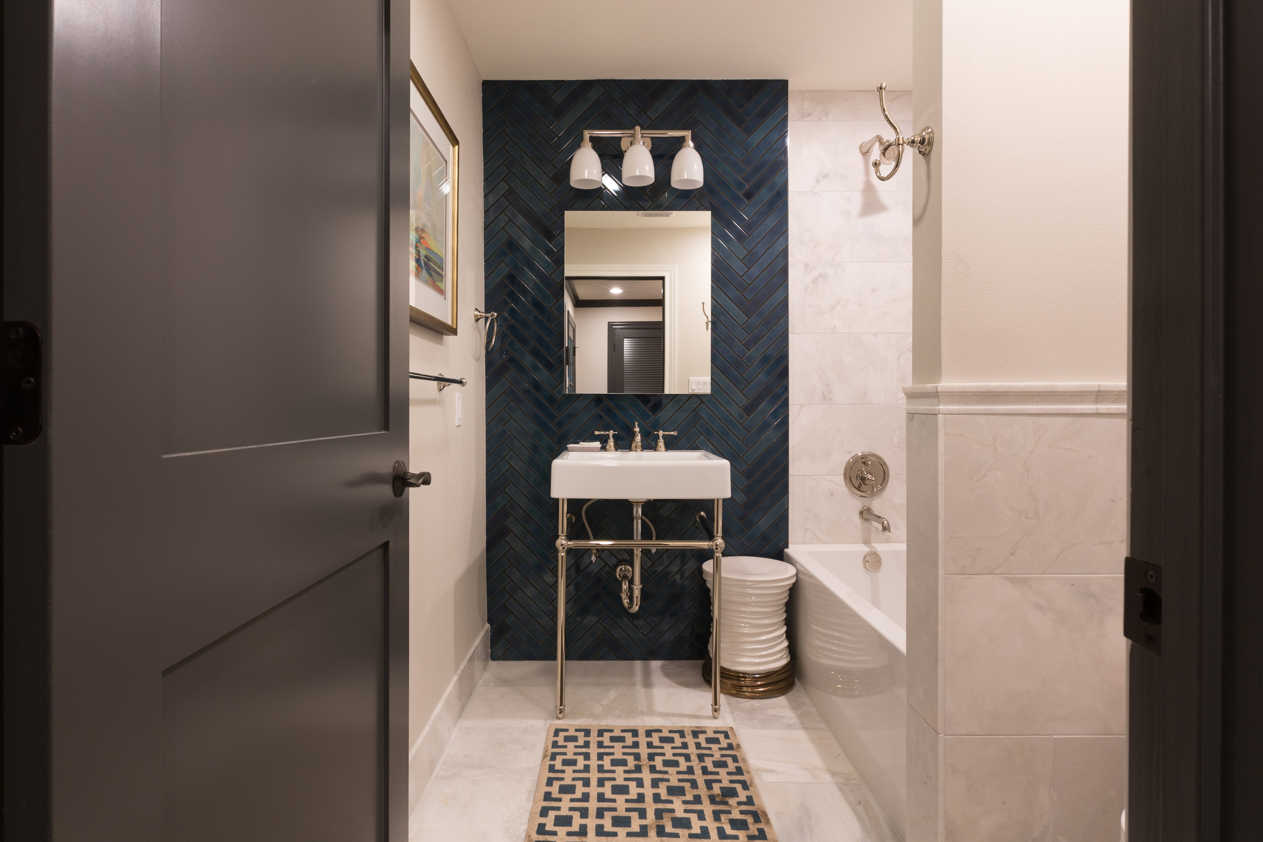 Stunning Ann Sacks tile in guest bathroom of remodeled condo