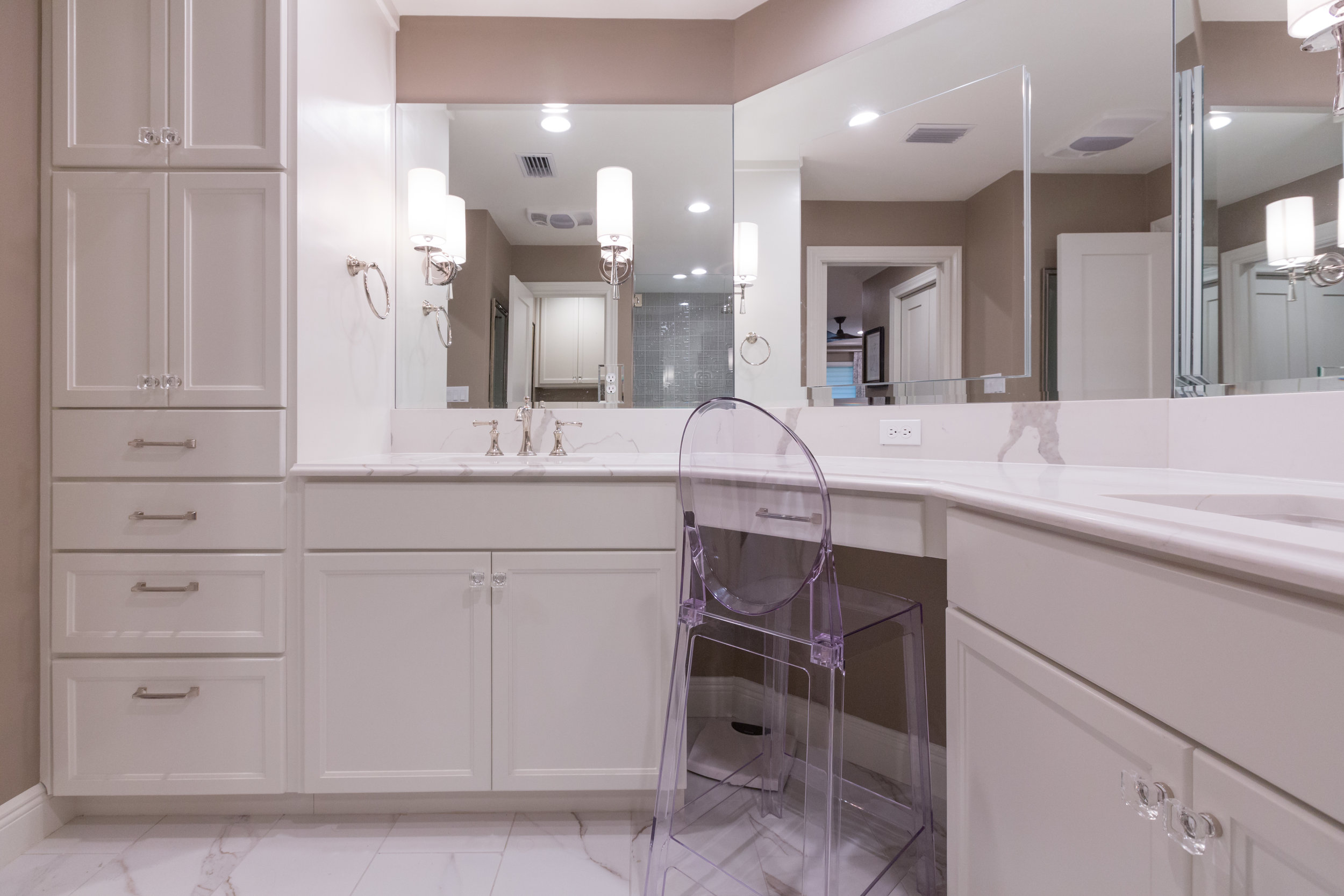 White bathroom featuring marble ceramic tile in renovated austin condo