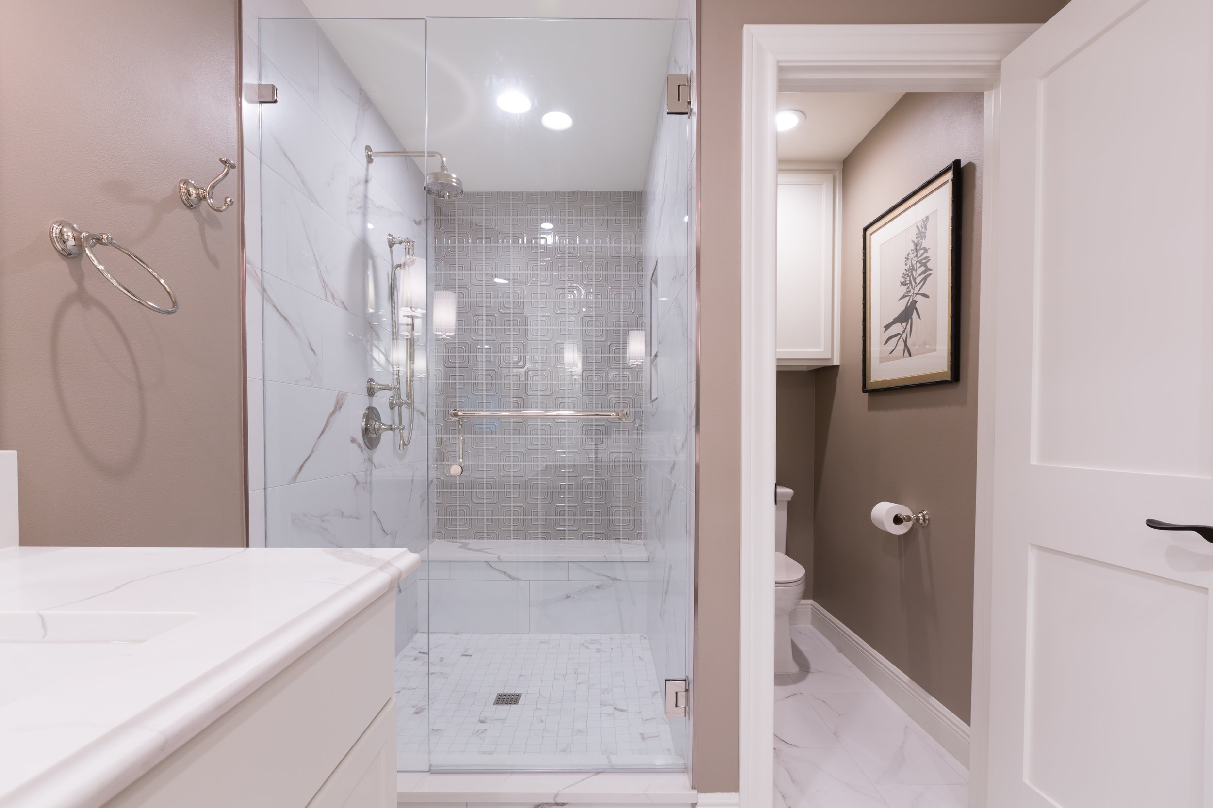 Remodeled austin condo bathroom featuring handmade shower tile