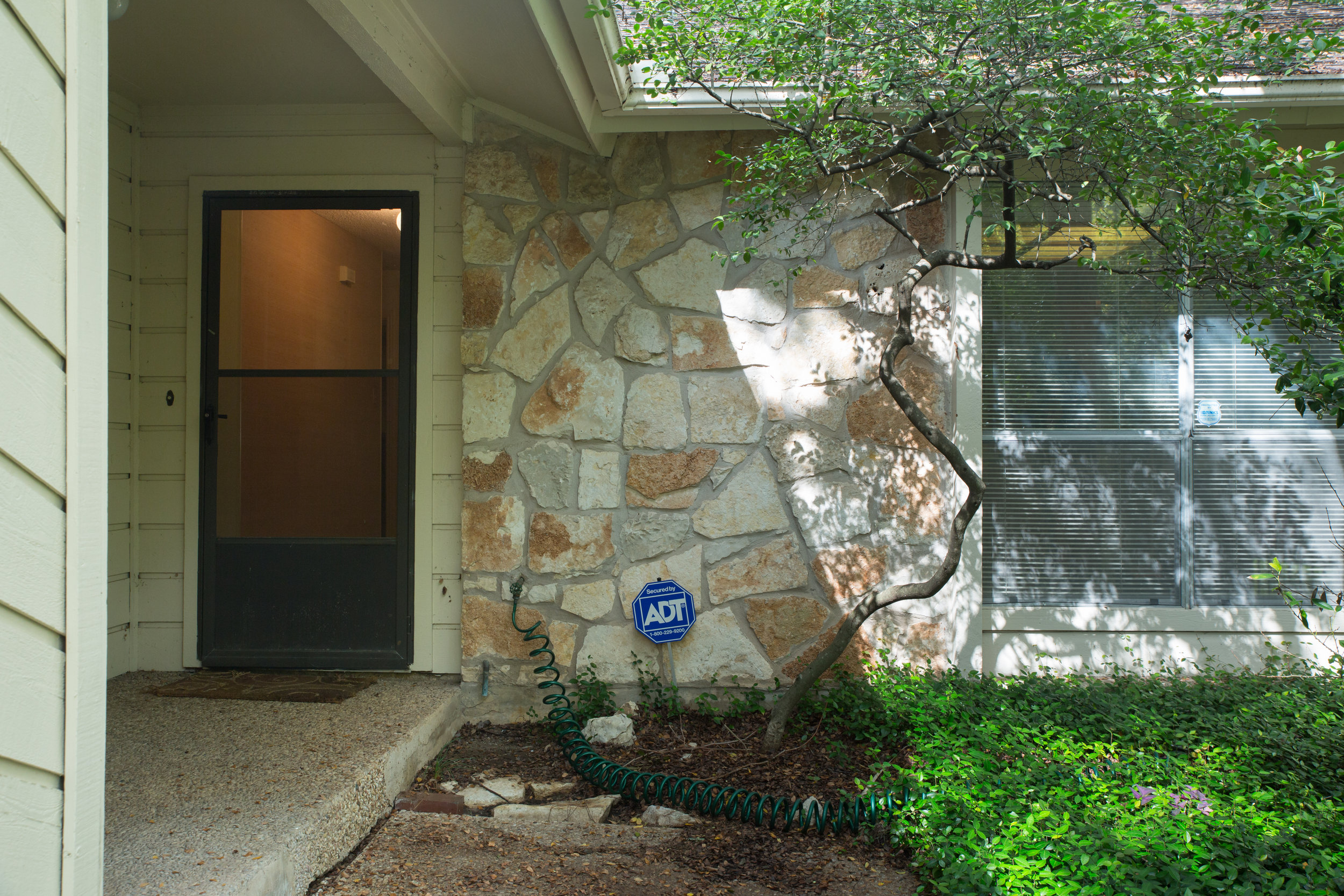 Before and after landscaping in dated austin condo