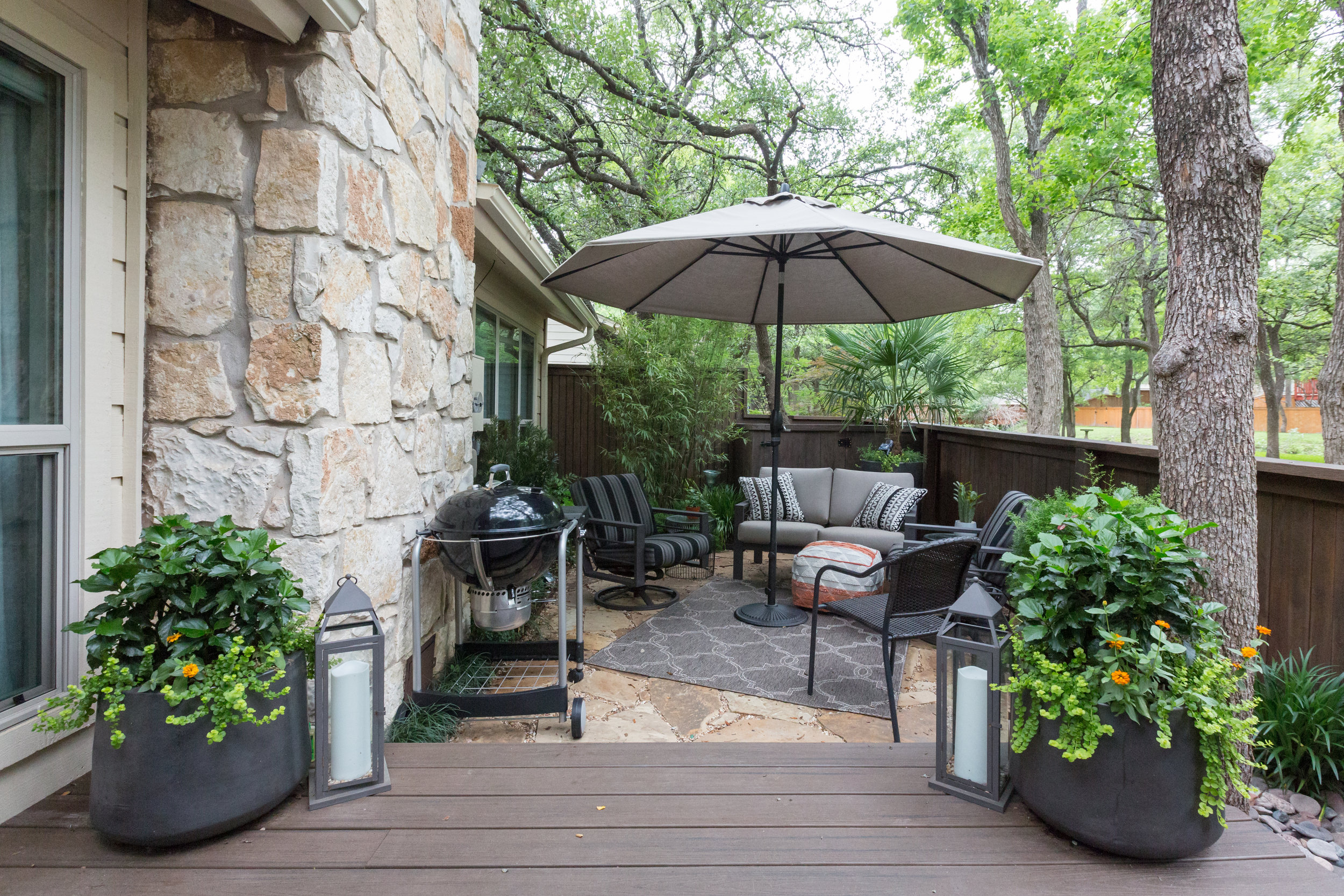 New patio furniture in newly landscaped back yard of renovated austin condo