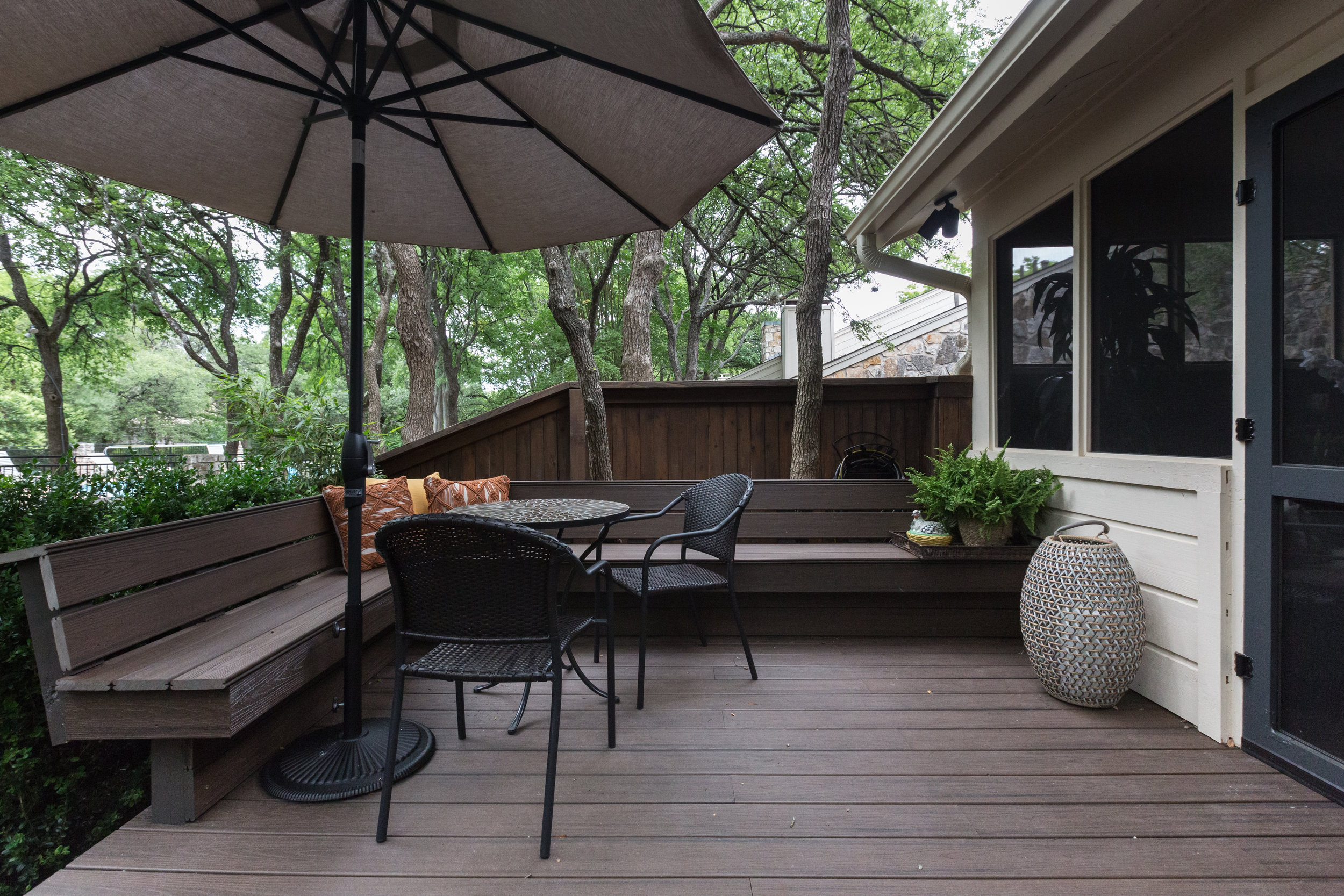 New deck with plenty of seating in backyard of renovated condominium