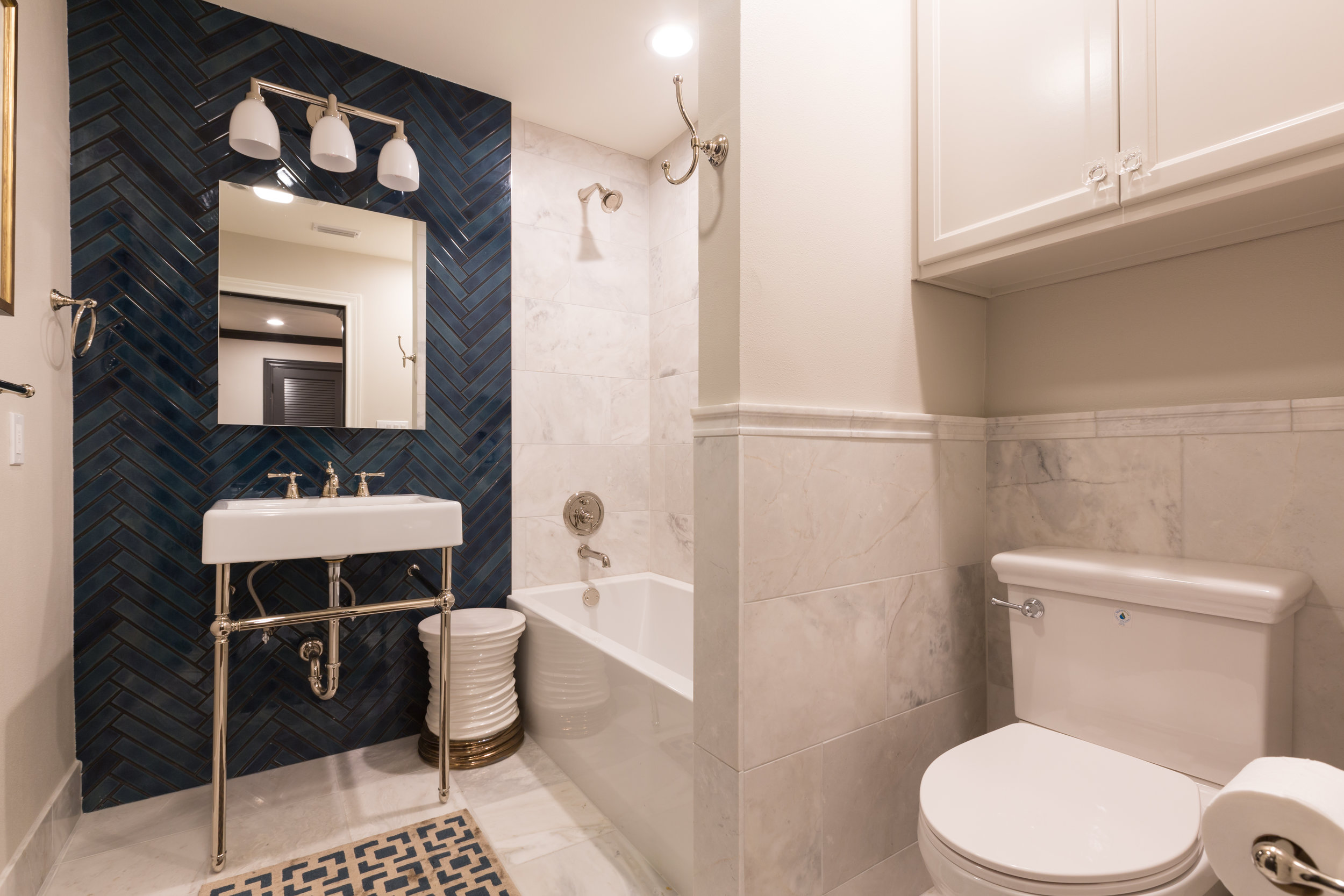 Updated Guest Bath Featuring Blue Tile Accent Wall