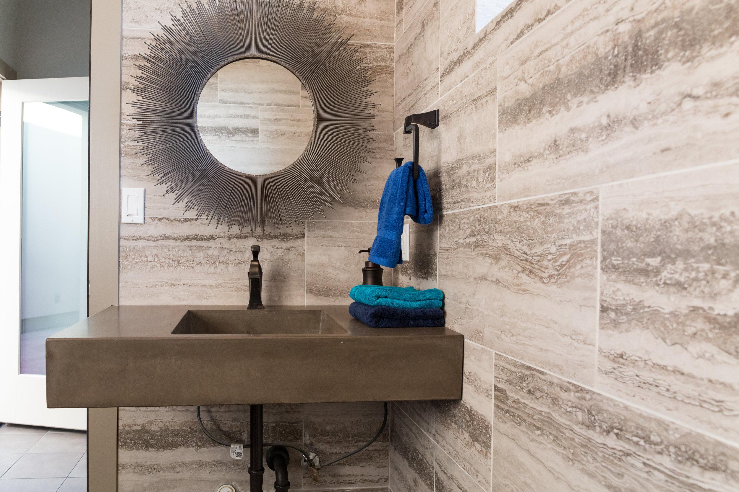 Cabana Bathroom Featuring Custom Concrete Sink