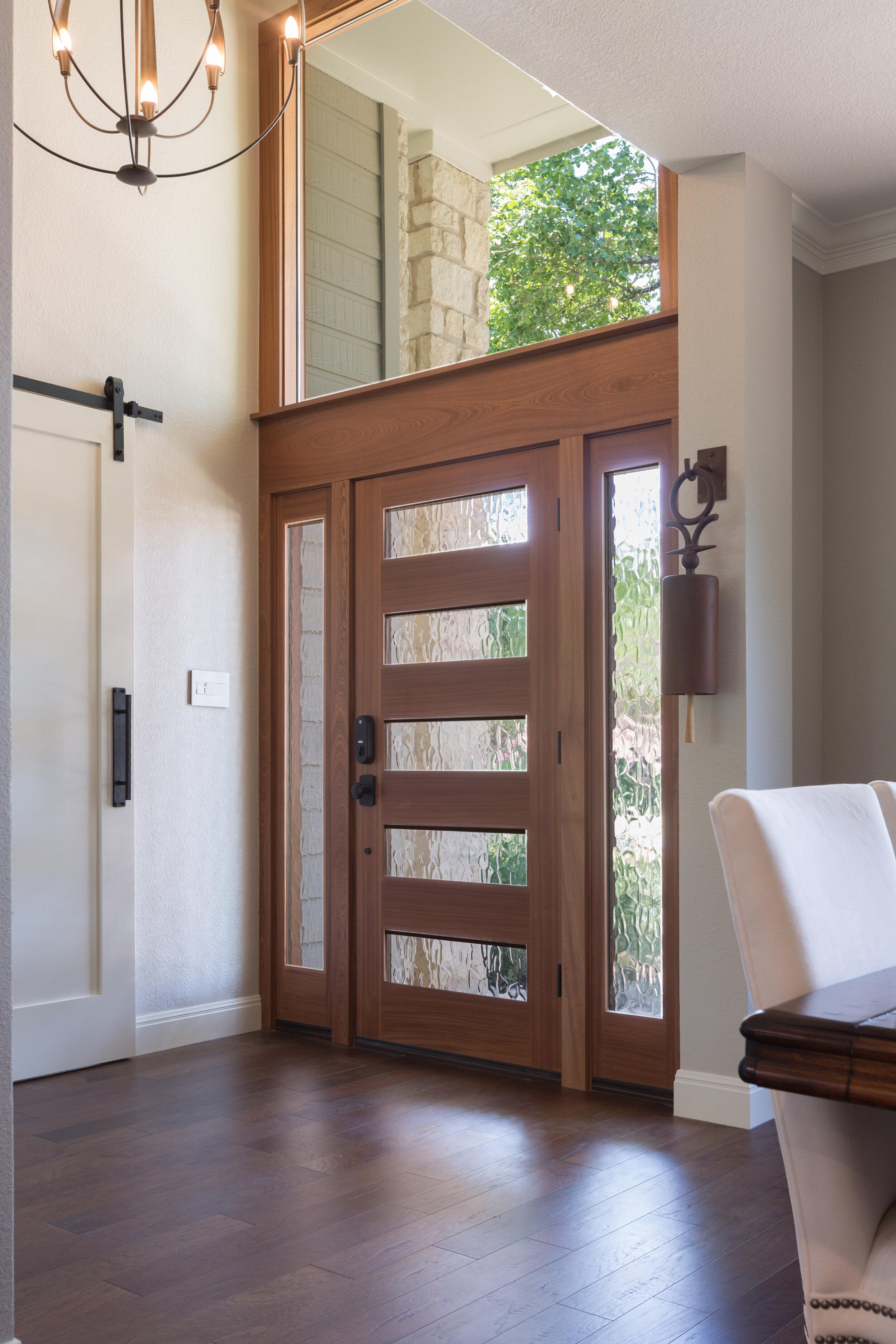 Modern Entryway door with chandelier
