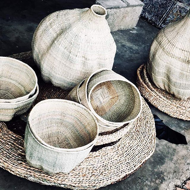 Can't get enough of our Ilala palm products. Beautiful gourd basket at the back, wonky baskets at the front, serving trays back right and seagrass rush mats completing the picture.  #basket #raw #consciousconsumer #interiors #styling #homewares #countryliving #coastalliving #handmade #weaving #africaninspired #africa #authentic