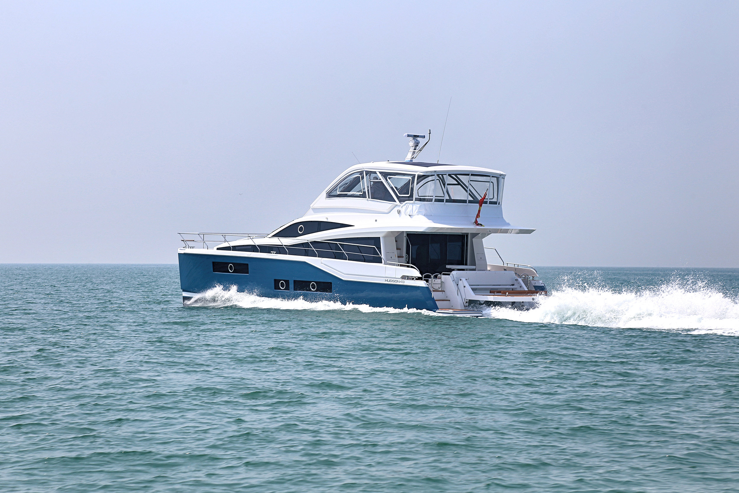 HPC48-06, owner's version, three cabins, with fully enclosed flybridge, and upper and lower helm stations.