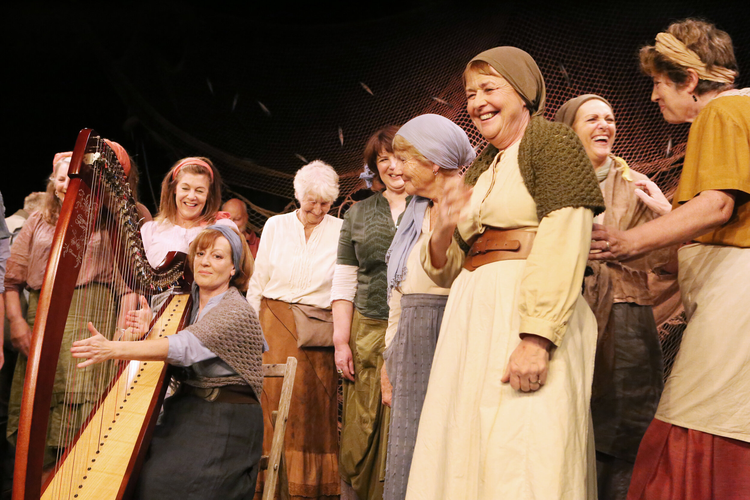 The Ladies singing 'The Cockle Gatherers' with Carmel on the harp 2019