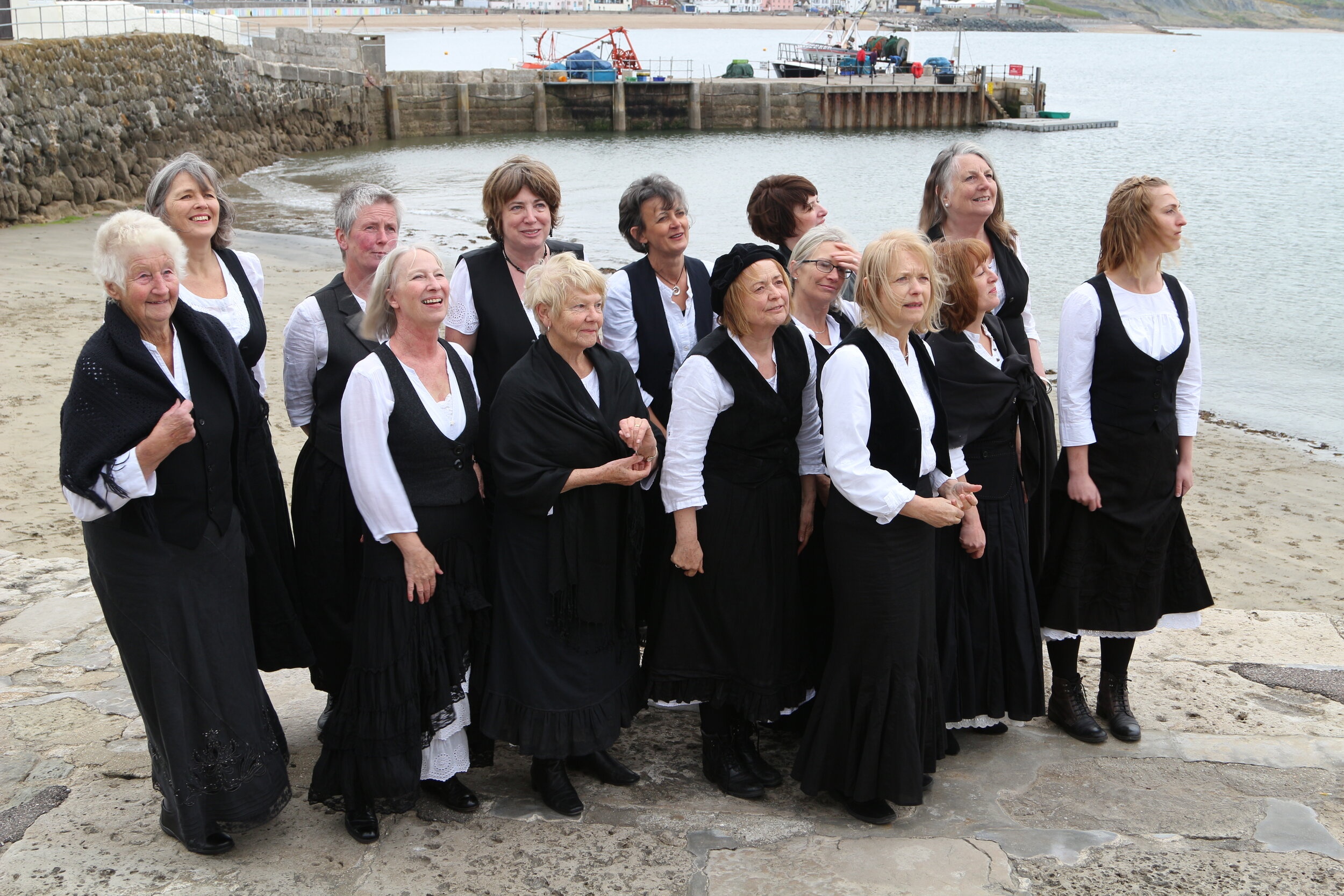The 'Fishermen's Wives' waiting for the men to come home,  the Cobb Lyme Regis 2017