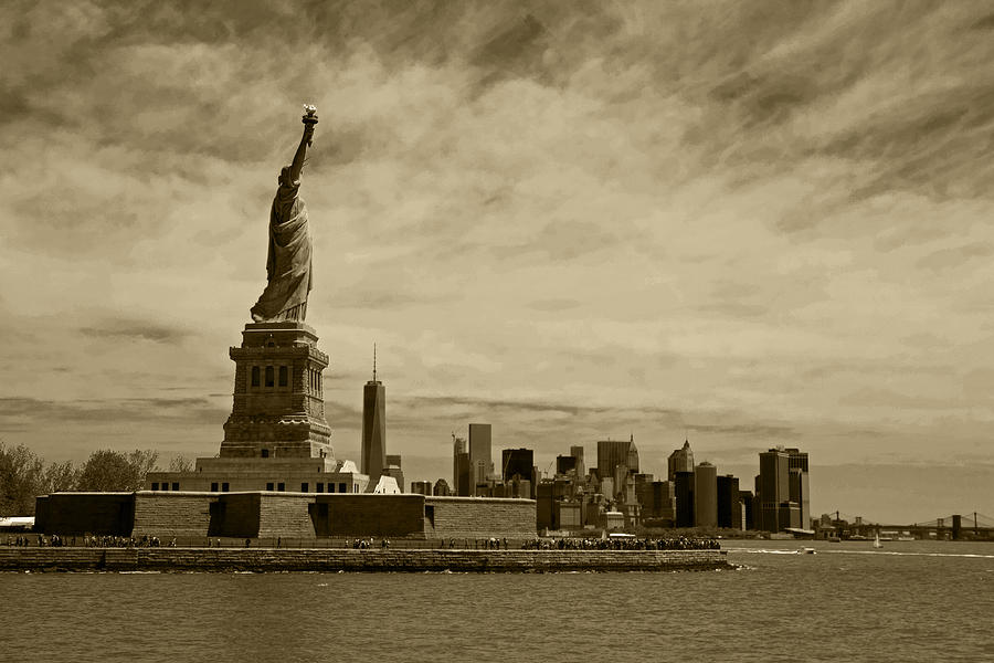lady-liberty-overlooking-new-york-city-sepia-toby-mcguire.jpg