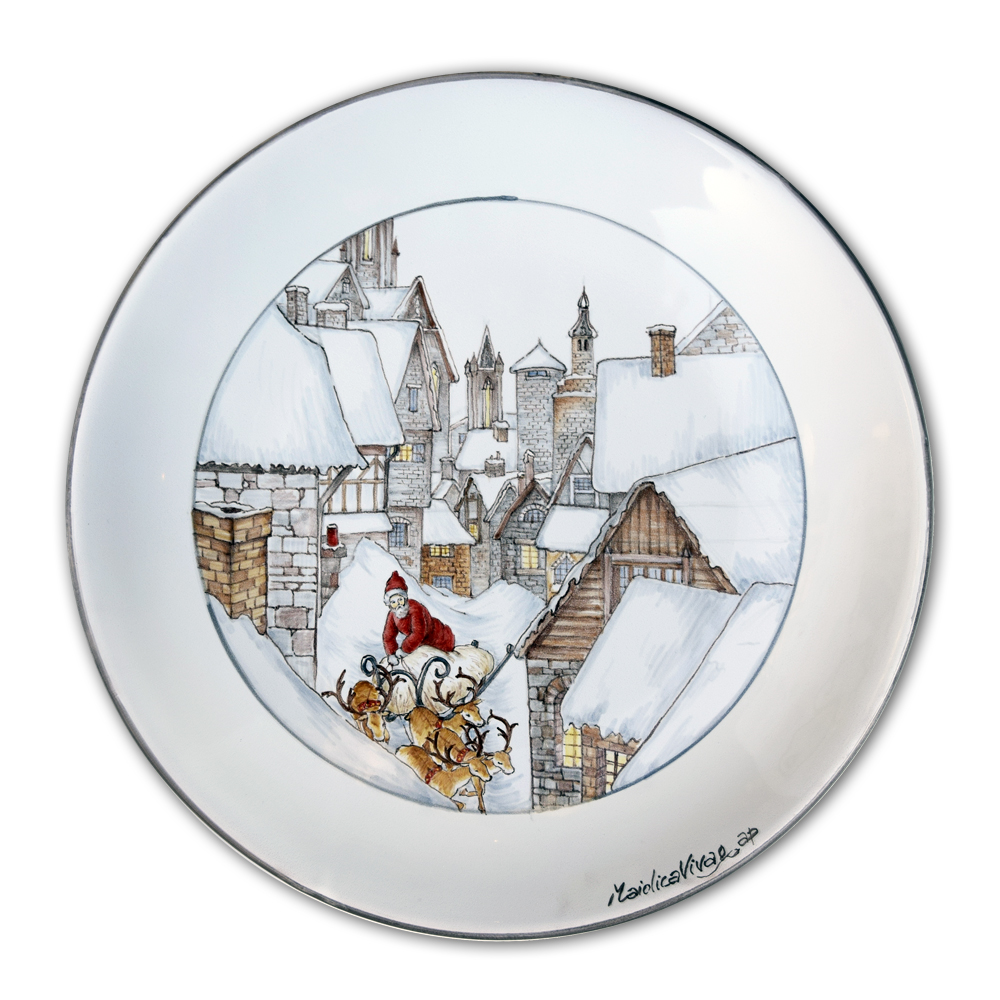 Decorative dish depicting a snow-covered village and Santa Claus on his sled (Ø 25 cm.)