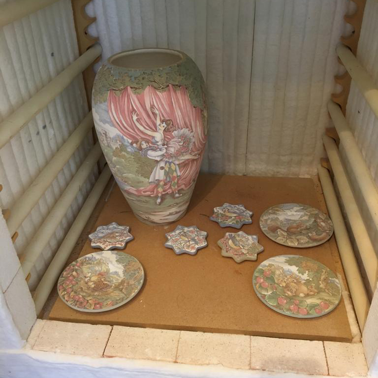 Loading the kiln – The glazes in this phase are still raw and they appear very tenuous