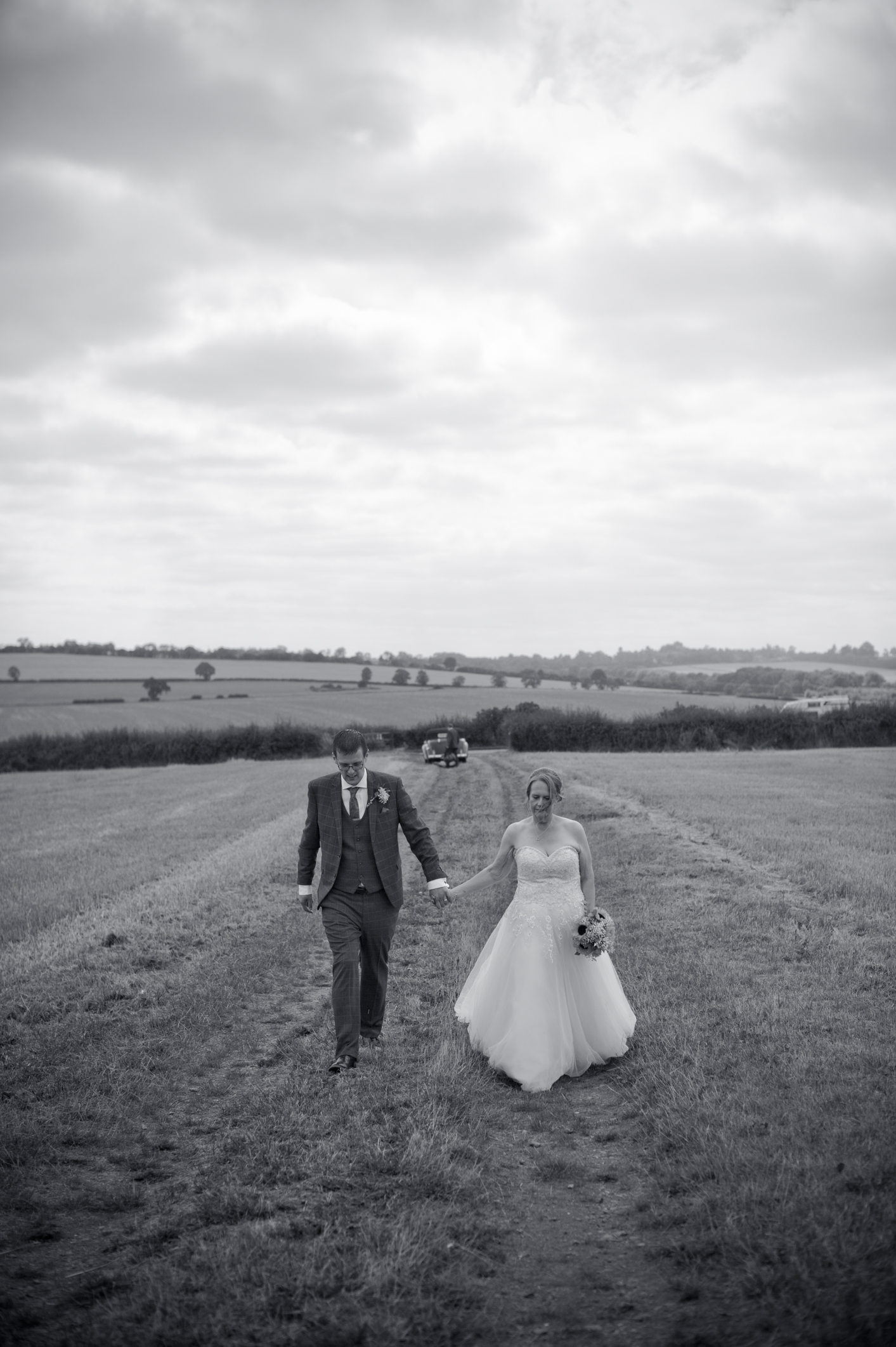 A shot of Duncan and Katy walking away from their car in the field Katy had arranged for us to have their photos taken.
