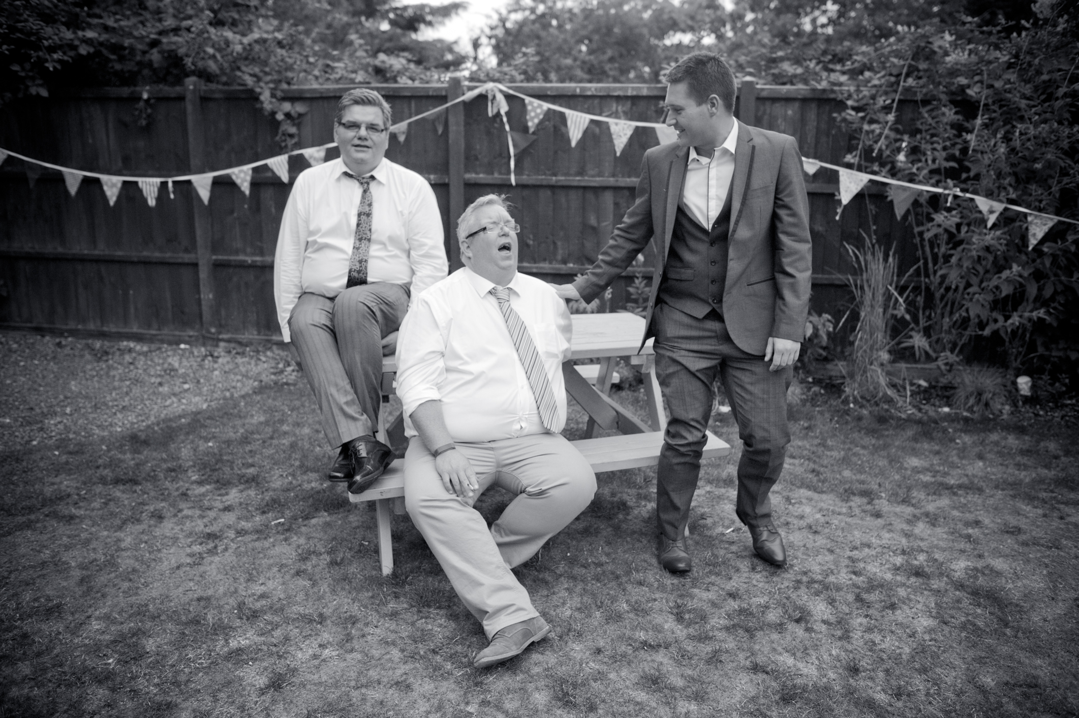 Afternoon wedding guests having a laugh.