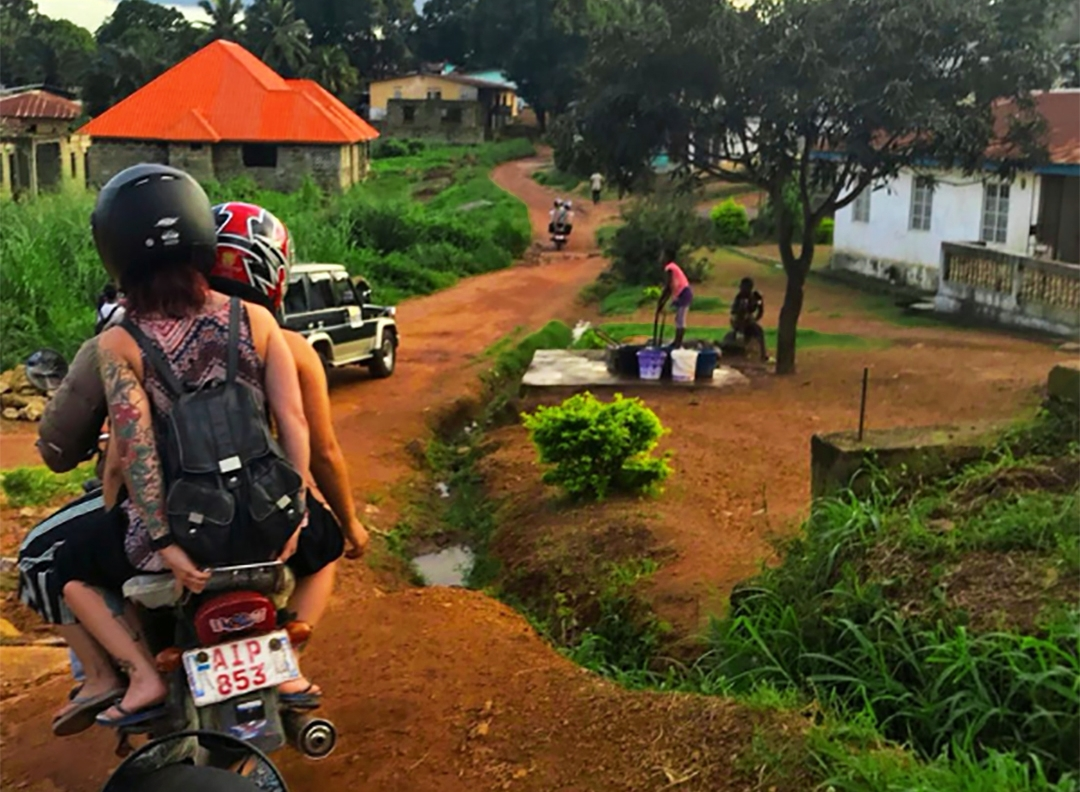 Moped ride to rural projects, Sierra Leone