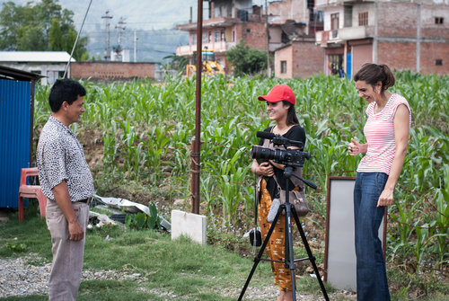 Filming in the field in rural Nepal