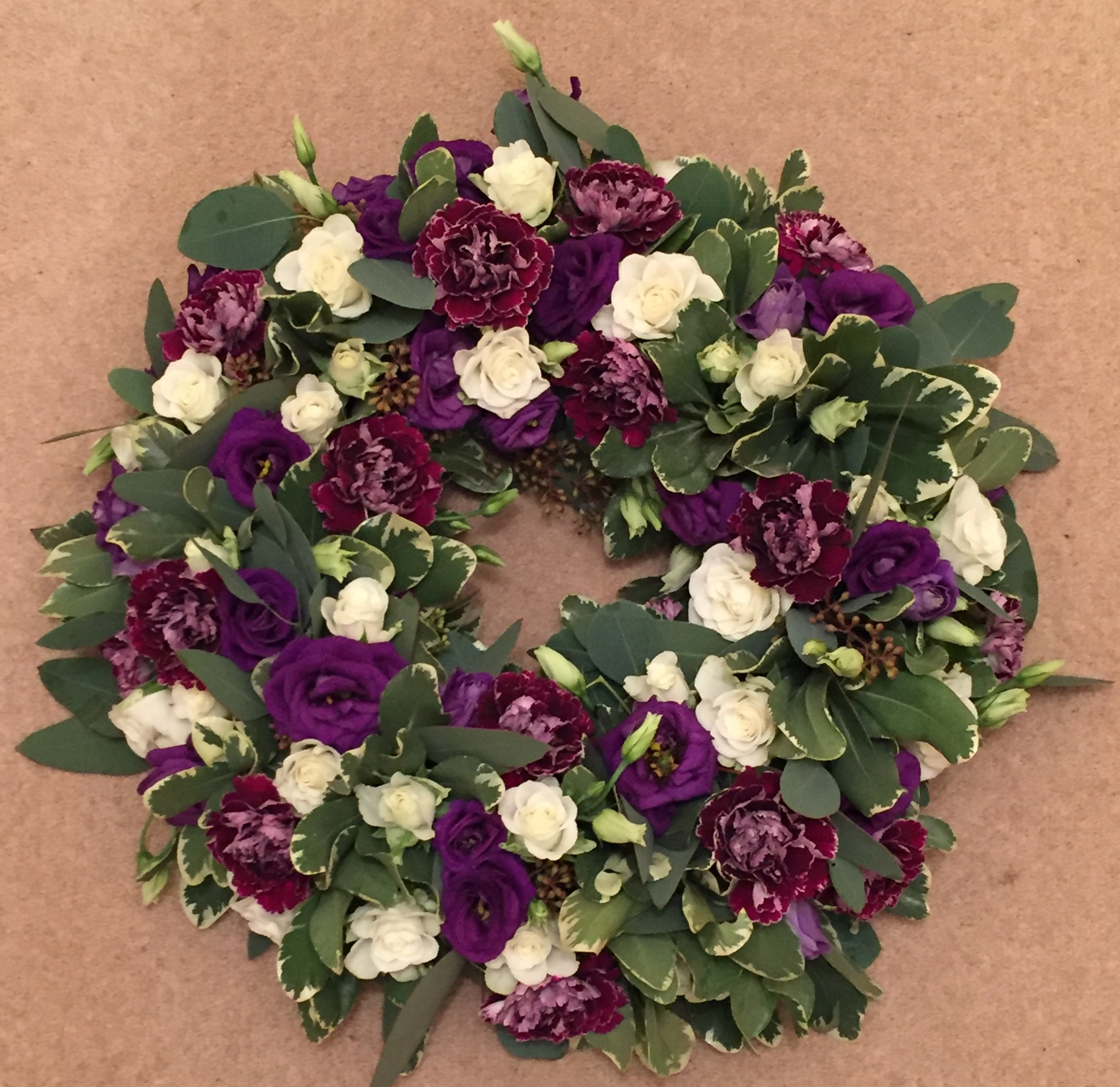 Wreath with Carnations and Lisianthus starting from  £45 (Wreath pictured £65)