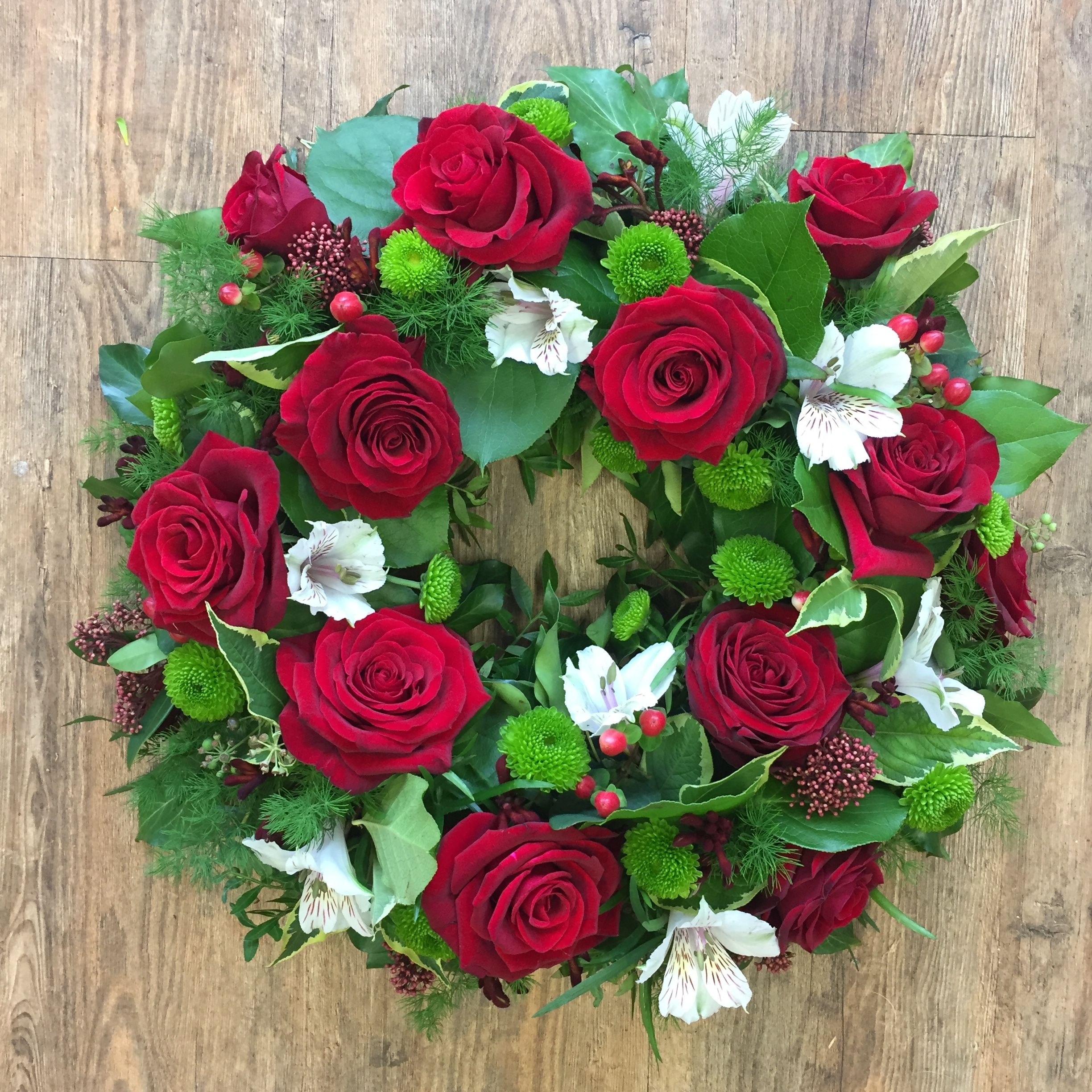Wreath with Red Roses and complimenting flowers and foliages starting from  £45 (Wreath pictured £65)