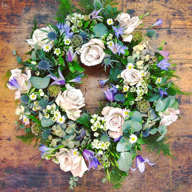 Natural Woodland Style Wreath with Roses starting from  £55 (Wreath pictured £60)
