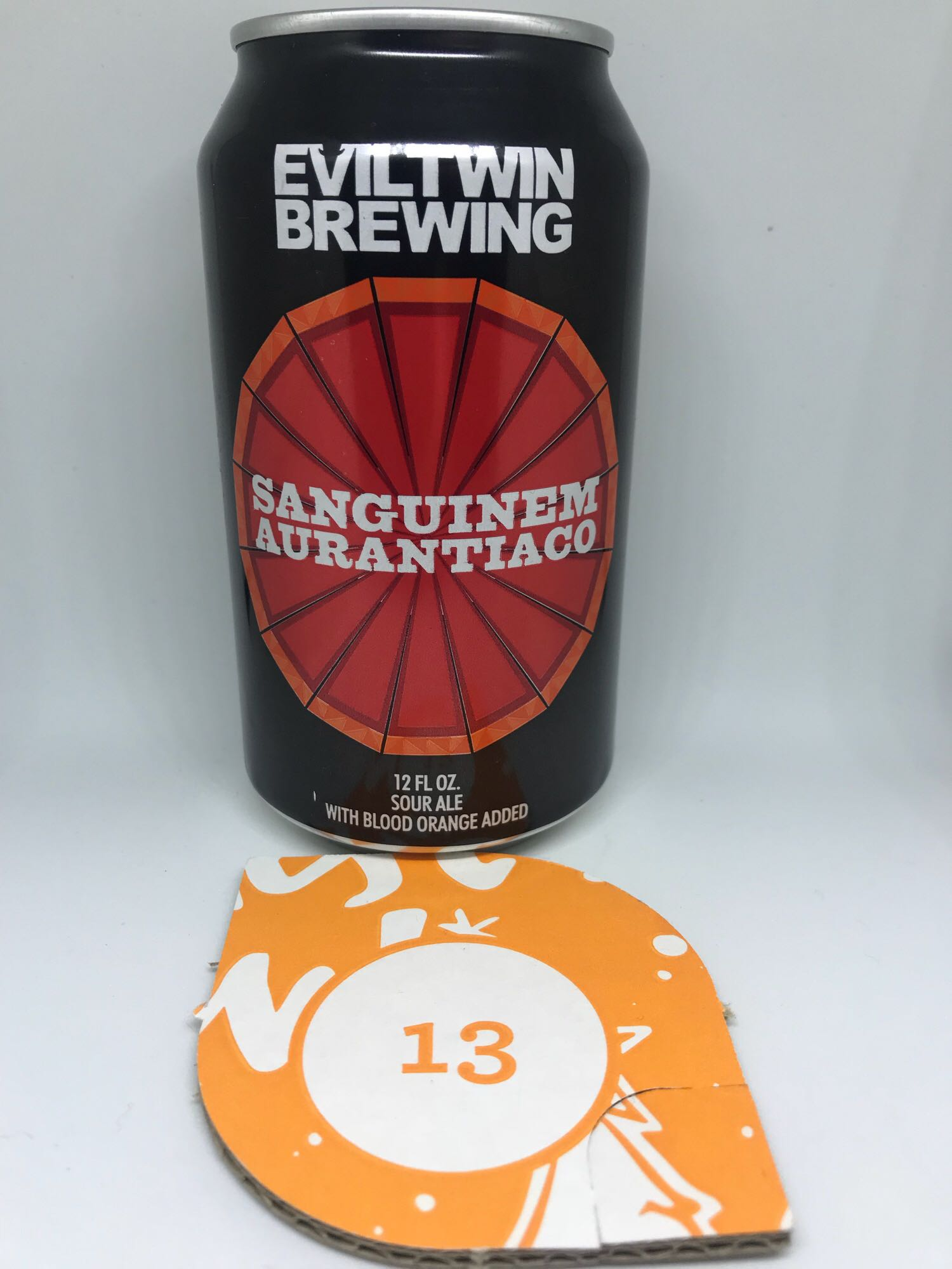 Day Thirteen: Sanguinem Aurantiaco - Sour Ale 3.25% // Evil Twin Brewing - 'Sanguinem Aurantiaco' is Latin for 'blood orange' so I was expecting a very bitter orange taste from the sour from Evil Twin Brewing. Sadly, there's not really any there at all.I'm a big fan of Evil Twin and so had pretty high hopes for this beer, the aroma bolstered these hopes even more so I was a bit letdown on first sip. Don't get me wrong, it's a fine sour but I'd never guess it was meant to be a blood orange sour unless I'd seen the can. At 3.25% it's the lowest ABV so far and I've drank it very quickly so this probably sounds harsher than it's meant to. Bit of a disappointment on the whole but you can't win 'em all I suppose. Onwards and upwards hopefully.