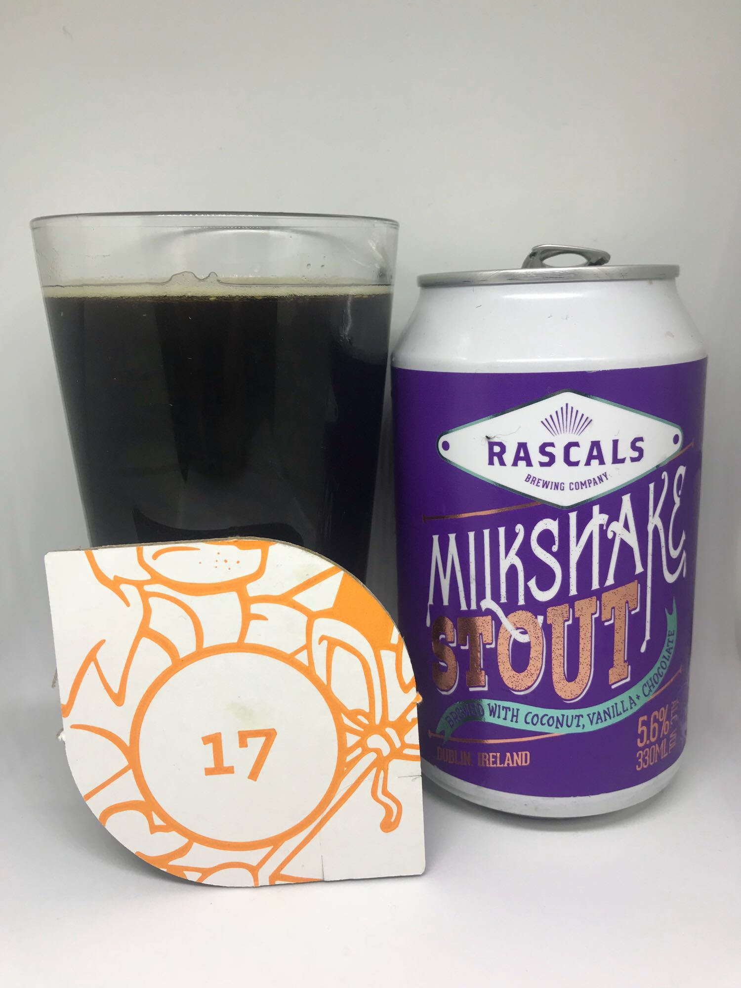 Day Seventeen: Milkshake Stout - Milk Stout 5.6% // Rascals Brewing Co.  - Four dark beers on the bounce now and another brewery I'm yet to try anything from in the shape of Dublin's Rascals Brewing Co. I was fully on board when I saw the name of the beer but when I spied 'coconut' as one of the ingredients, my heart sank a little. I may start a one man crusade to keep coconut out of beer because it is SICK and WRONG.Luckily, the biggest flavour here is vanilla so it's not as bad as I was expecting. It's very, very sweet which is to be expected in a beer called 'Milkshake Stout' and is pretty enjoyable. The vanilla dominates but then the dreaded coconut rears its head at the end and takes it down a notch for me. Decent but nothing that's going to set the world alight.