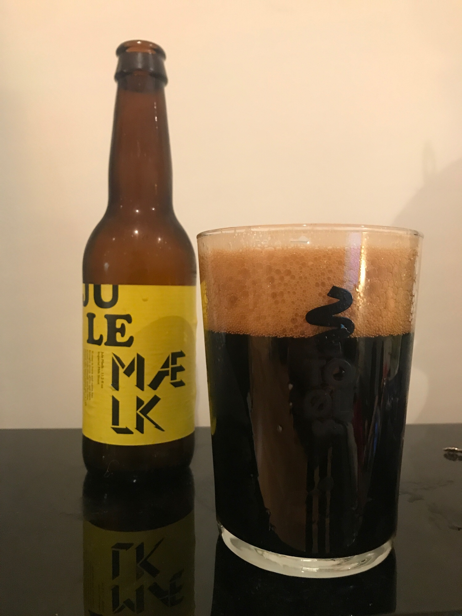 Day Five: Jule Mælk // Imperial Sweet Stout 15% - Far more fitting for an advent calendar. A beer I've long coveted makes an appearance for day five.At 15% I was expecting a real bitter and boozey number in keeping with previous imperial stouts I've had but this is sweet with a capital S. I had to double check the percentage because this drinks very easily for it's ABV.It's full-bodied due to the high amount of lactose in it which makes this feel like drinking a milkshake. The sweetness stays for the remainder and there's only a tiny bitterness kicking in at the backend to remind you this is actually alcohol so probably don't chug it.It takes a while to adjust to the sweetness here unless you expect it but it's a very welcome and different interpretation to the style. To Øl make a lot of variants of this beer (a whiskey version, a tequila version and a milkshake version) and I'm very keen to hunt them all down on the back of this beer. An absolute belter of a beer.