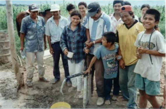 "This is a ""water club"" in the poor rural village of San Miguelito, in Eastern Bolivia.  They just drilled their first water well 170 ft deep.  They drilled 10 wells.  Each familiy now has a well. See the guy in the white hat.  His name is Norberto.  He liked drilling with our technology so much he started his own little buisness and has drilled dozens more wells charging prices much lower than drilling companies charge.  Everyone in the area can now have a well if they want one!   Norberto was also a leader in the village Baptist church.  We have helped over 1700 families drill their own water wells and started dozens of village level drillers drilling for their neighbors."