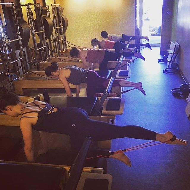 Your reminder to schedule your workouts this week! ⠀⠀⠀⠀⠀⠀⠀⠀⠀ These clients are working into their glute and hamstring muscles, stabilizing in their core, and getting a full body workout.  Work on your strength training in our Mat & Reformer classes or get your cardio on in our Accelerate, Fusion or Cardio Blast classes!