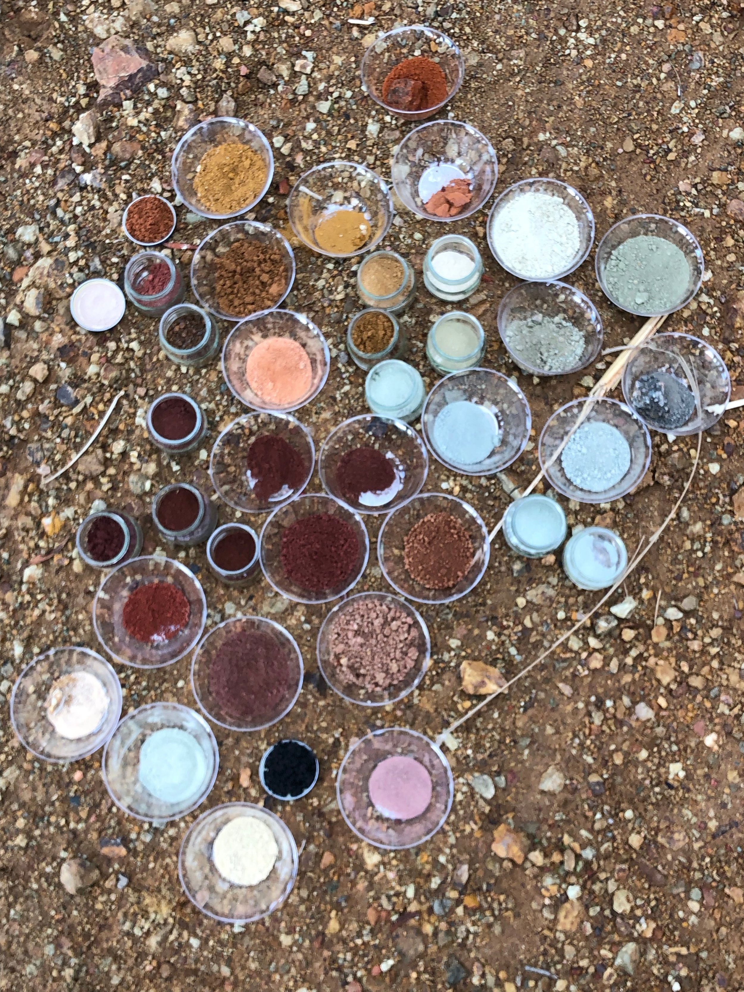 OCHRE SPECTRUM - After pulverizing and sieving our rocks, we took a pigment group photo, documenting the hidden rainbow in our backyard.