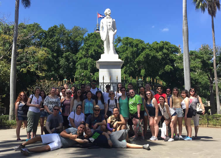 Carlos Lazo's class visiting the Plaza de Armas in Havana.