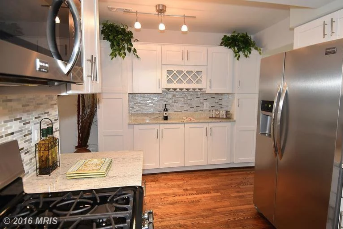 Photo by Chris Piller: Same kitchen as above, opposite wall space made into additional cabinet and storage space.