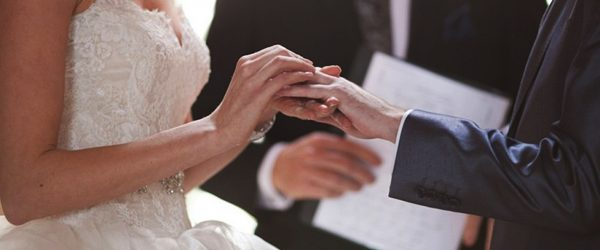 traditional-wedding-vows-bride-groom-rings-hands-sarah-bray-photo-600x250.jpg