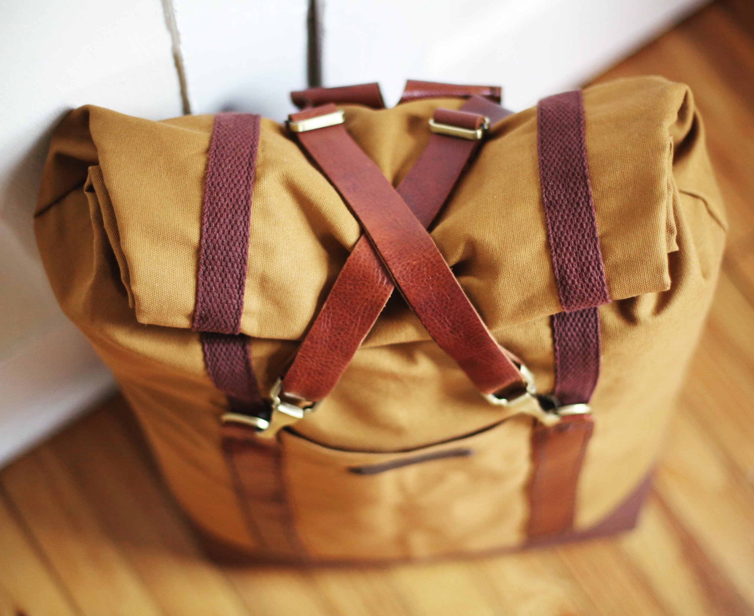 Whiskey Leather + Canvas Roll-Top Travel Backpack $130+