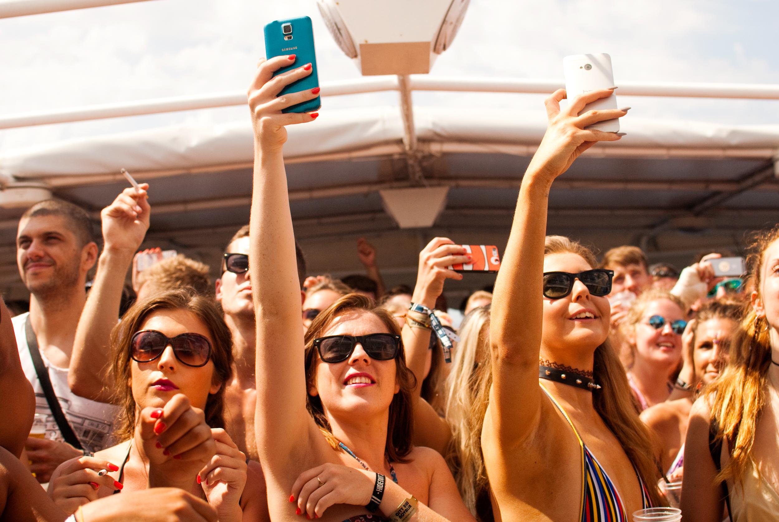 GeorginaCook_hideout_festival_croatia_boat_party_girls_phone.jpg