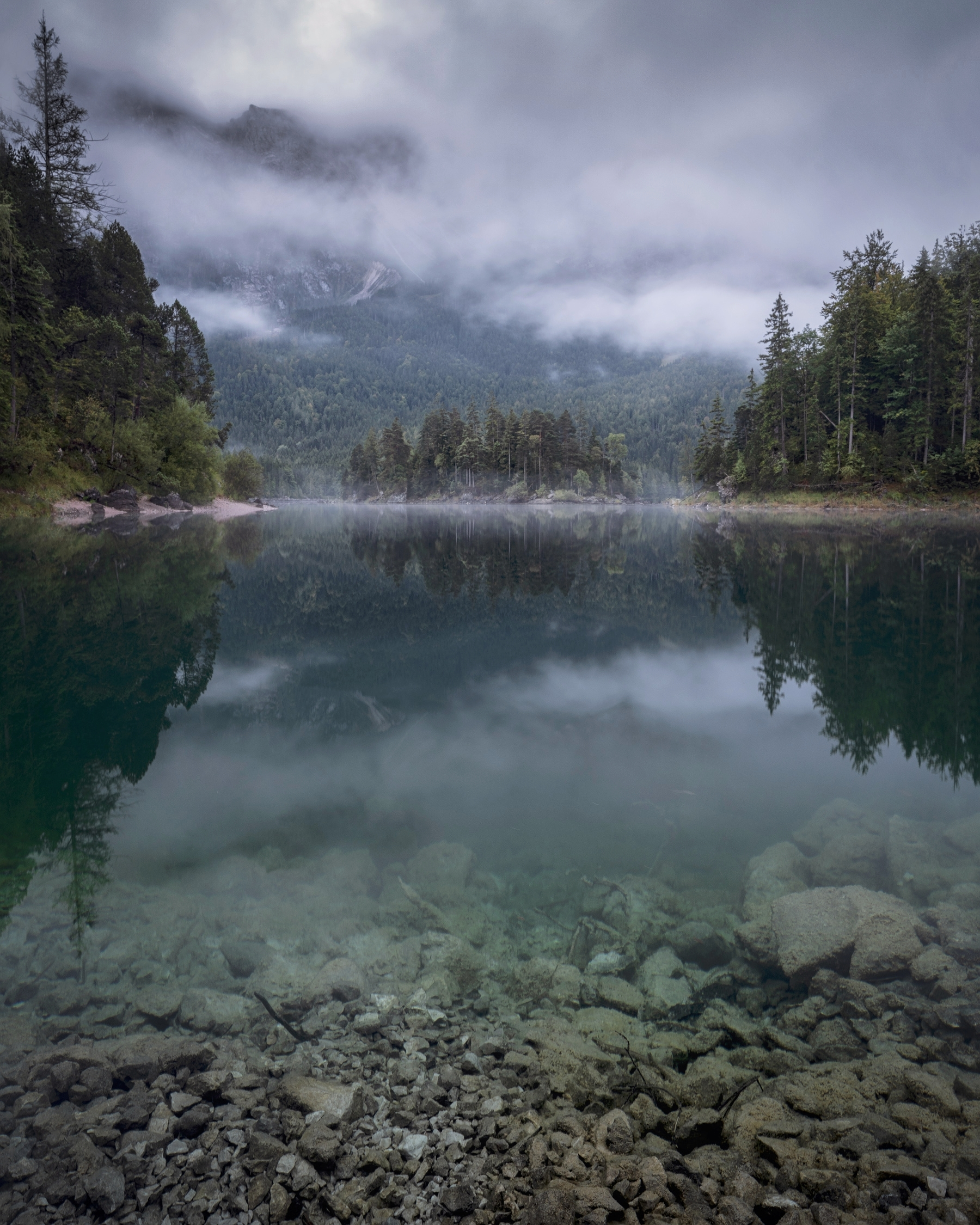 early morning at Eibsee, Germany. The  NanoPro MC CPL (Circular Polariser)  was used to help see through the clear water of the beautiful lake. The tripod was placed into the water of the lake. The pol filter did a good job revealing a clear view through the water.