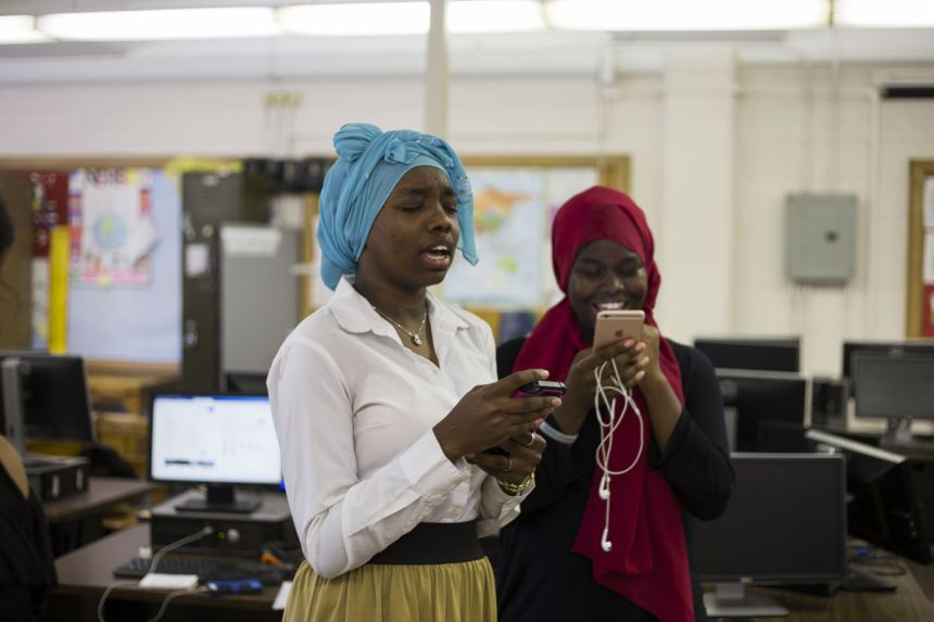 Estella Edward and Gabrielle Acuedo practice the song they'll sing at a graduation ceremony for their after-school program for refugee students.