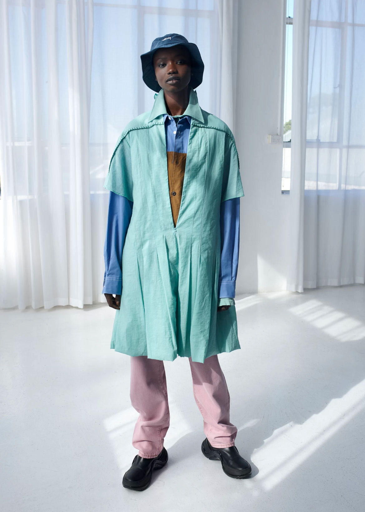 Agi Akur, model @ IMG, wears hat Stussy, shirt Supply Store, top, dress and pants Acne Studios, shoes Louis Vuitton.
