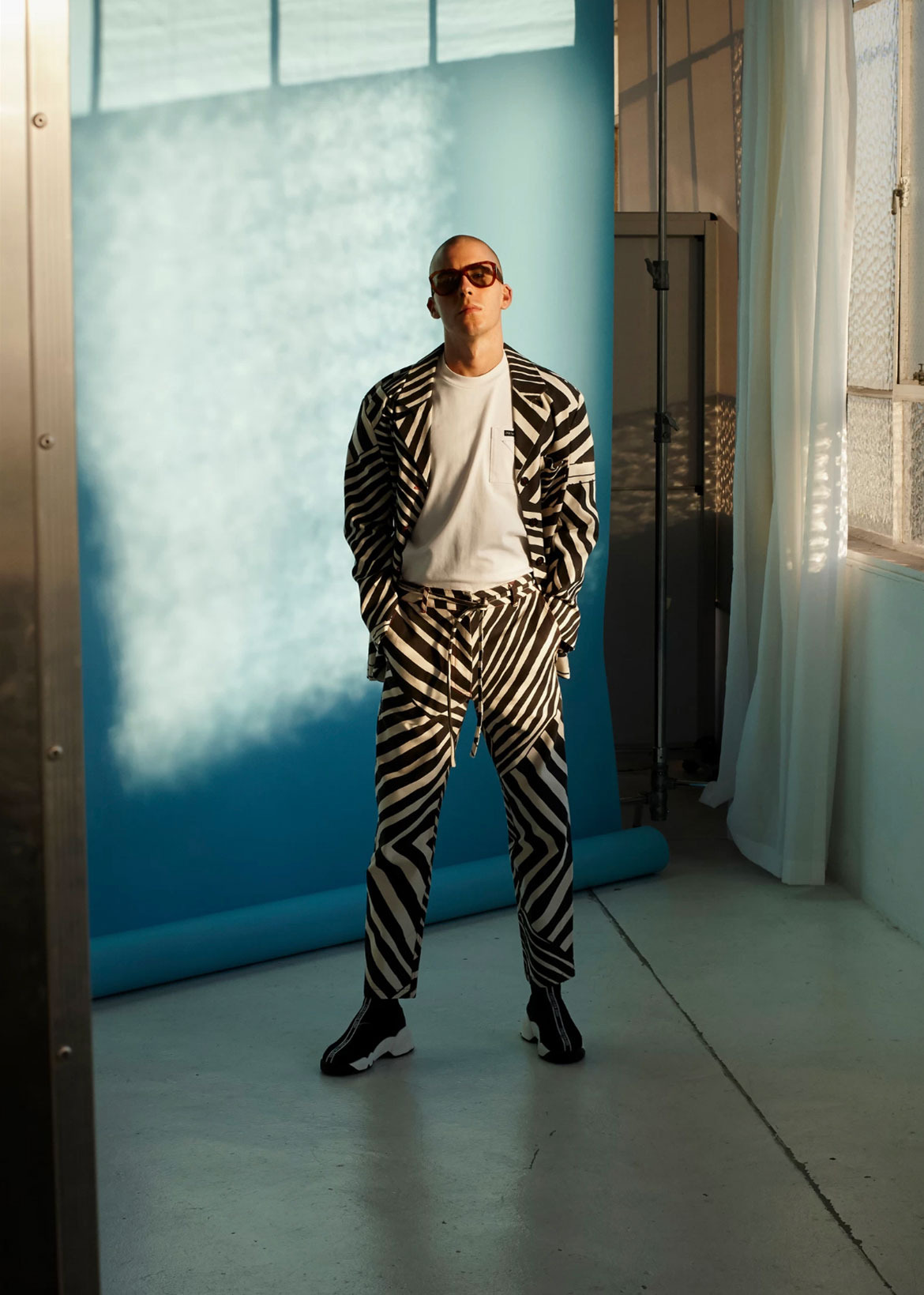Matthew Gode, choreographer, wears jacket and pants Lisa Waup x Verner, t-shirt Prada, shoes Dior.