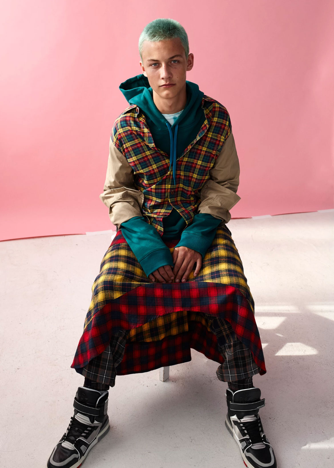 Kye Lister, model @ Kult, wears shirt Stussy, hoodie, ants and skirt Perks and Mini, shirt Supply Store, shoes Louis Vuitton.