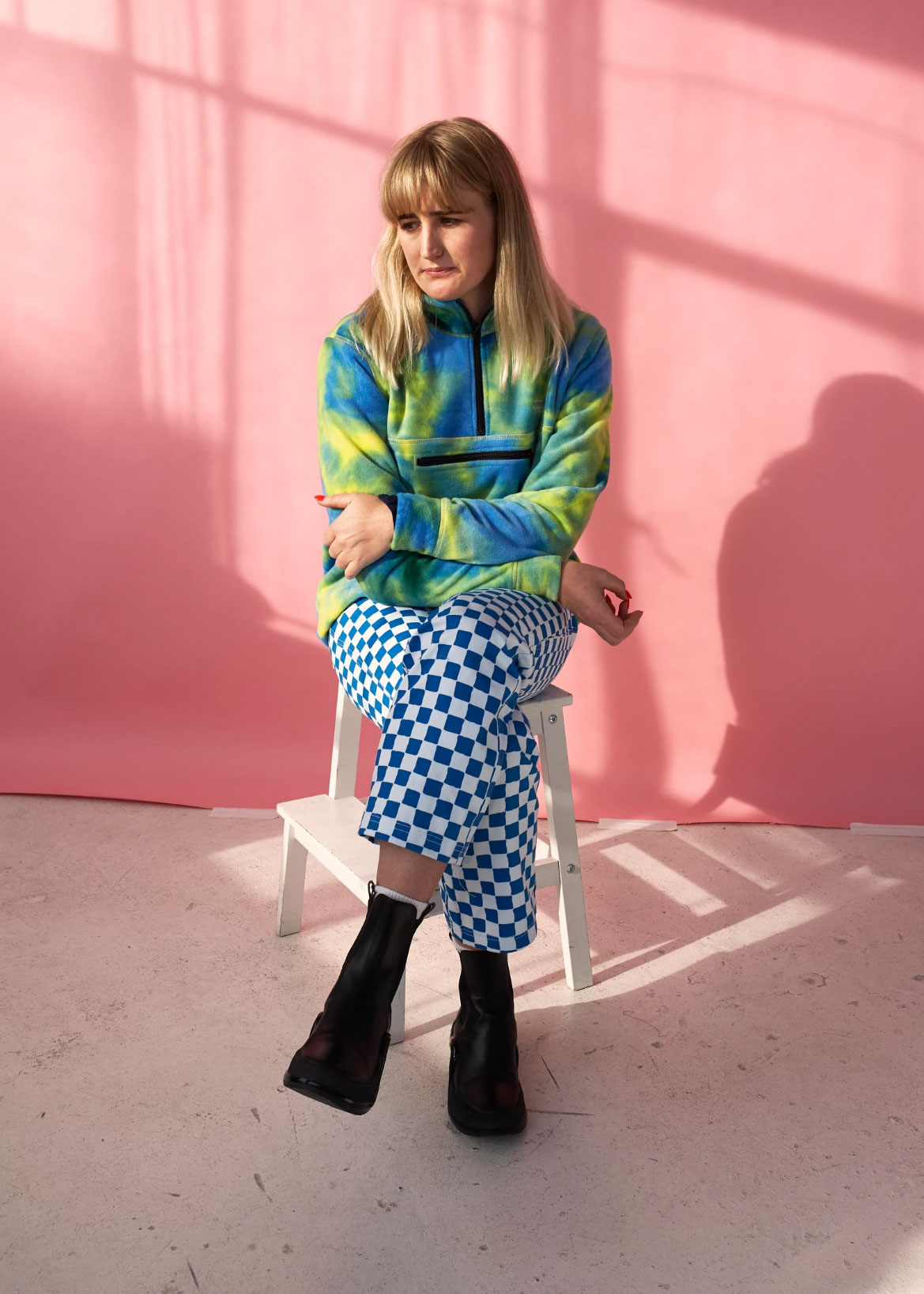 Emma Mulholland, designer of Holiday the Label, wears jumper Stussy, pants Holiday the Label, shoes Louis Vuitton.