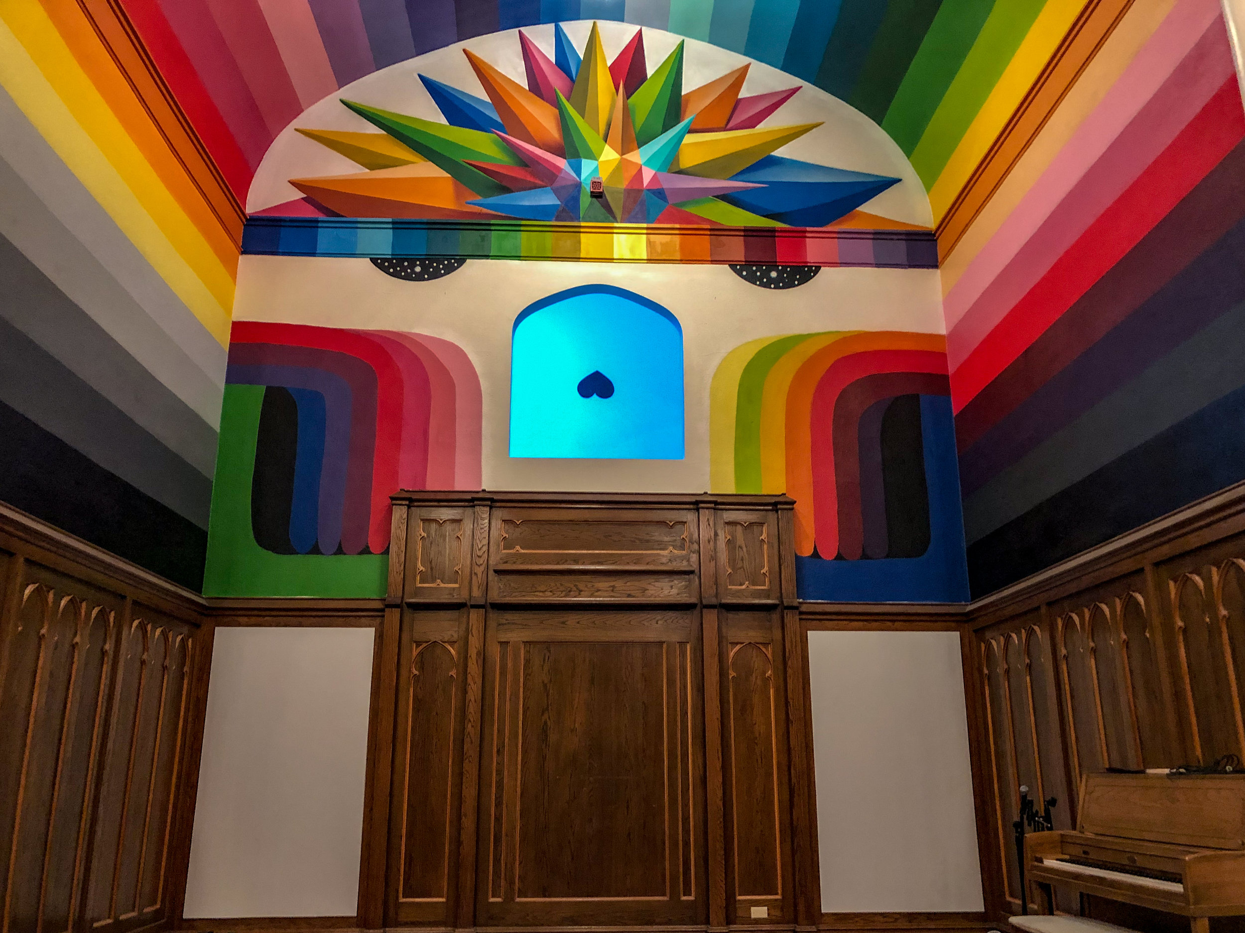 The brightly colored back wall of the church.