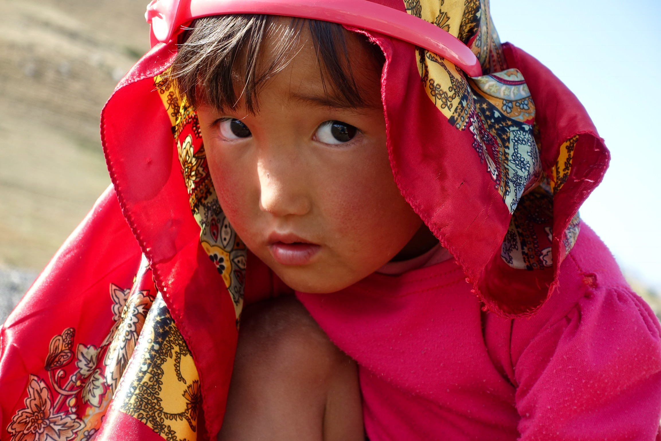 Shy little girl on the way to Sary Tash