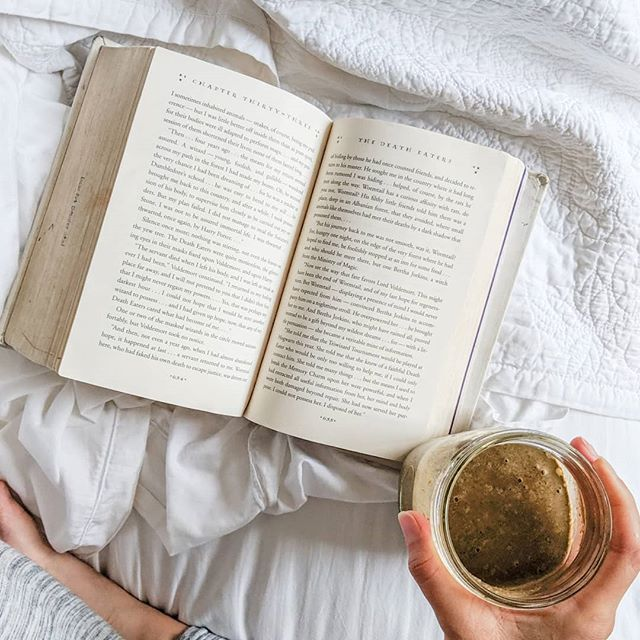 Taking time to read every day is one of my favorite (and essential) self-care practices. Few things make me happier than a good book. • I'm plugging along happily on my 2019 resolution to read the entire Harry Potter series this year - I finished the 4th one yesterday and loved it. (Obviously.) • We're entering my FAVORITE reading season of the year... because it's @annebogel annual Summer Reading Guide. It released this week and I'm absolutely giddy with excitement. • Every year, I read all of the books (at least, I start all of them...if I don't like one, I quit it without a problem), and this year's list is SO GOOD. • If you want to get your hands on the list and read along with me, visit @annebogel website, Modern Mrs. Darcy, and sign up to get it! It's the best part of summer. • What are you reading right now? What are you planning to read this summer? Do you agree that there's nothing better than a good novel read poolside? #IdRatherBeReading #summerstooshort